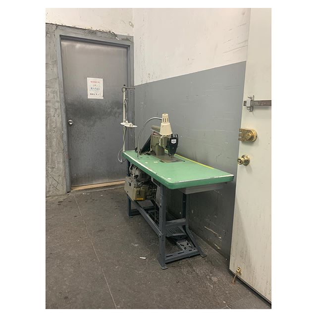 Factory building hallway scene - a machine awaits a repair service near the freight elevator