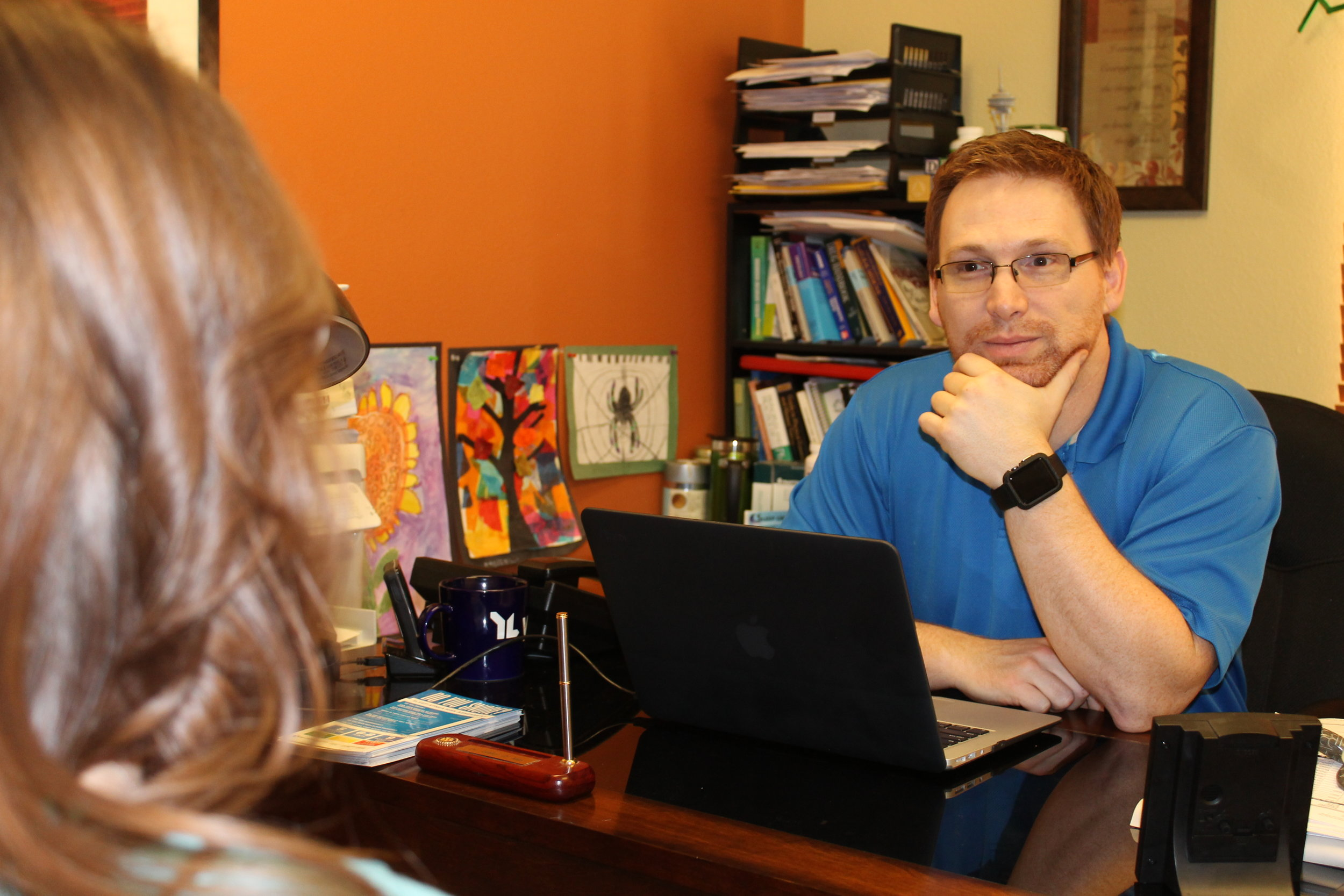 Dr. Ashley May, ND listening to his patient at the Alaska Center for Natural Medicine.