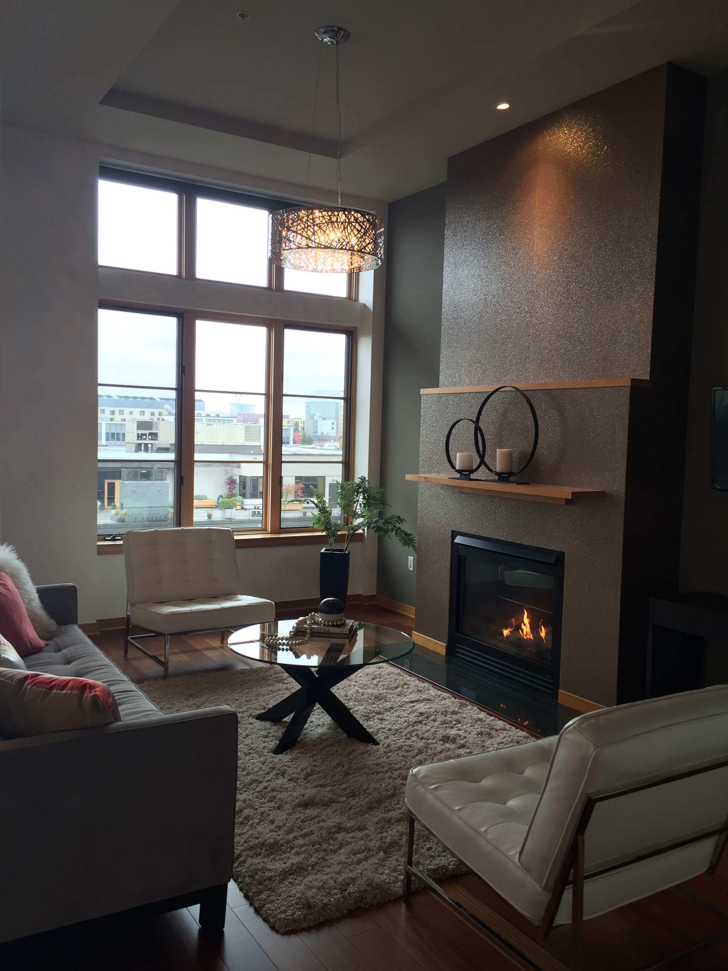 This condo in the Pearl District was absolutely amazing! It was two stories with perfect views, warm textures, and beautiful rooms that never seemed to end. This fireplace was covered with a matte glitter, which gave it a luxe yet sophisticated look.