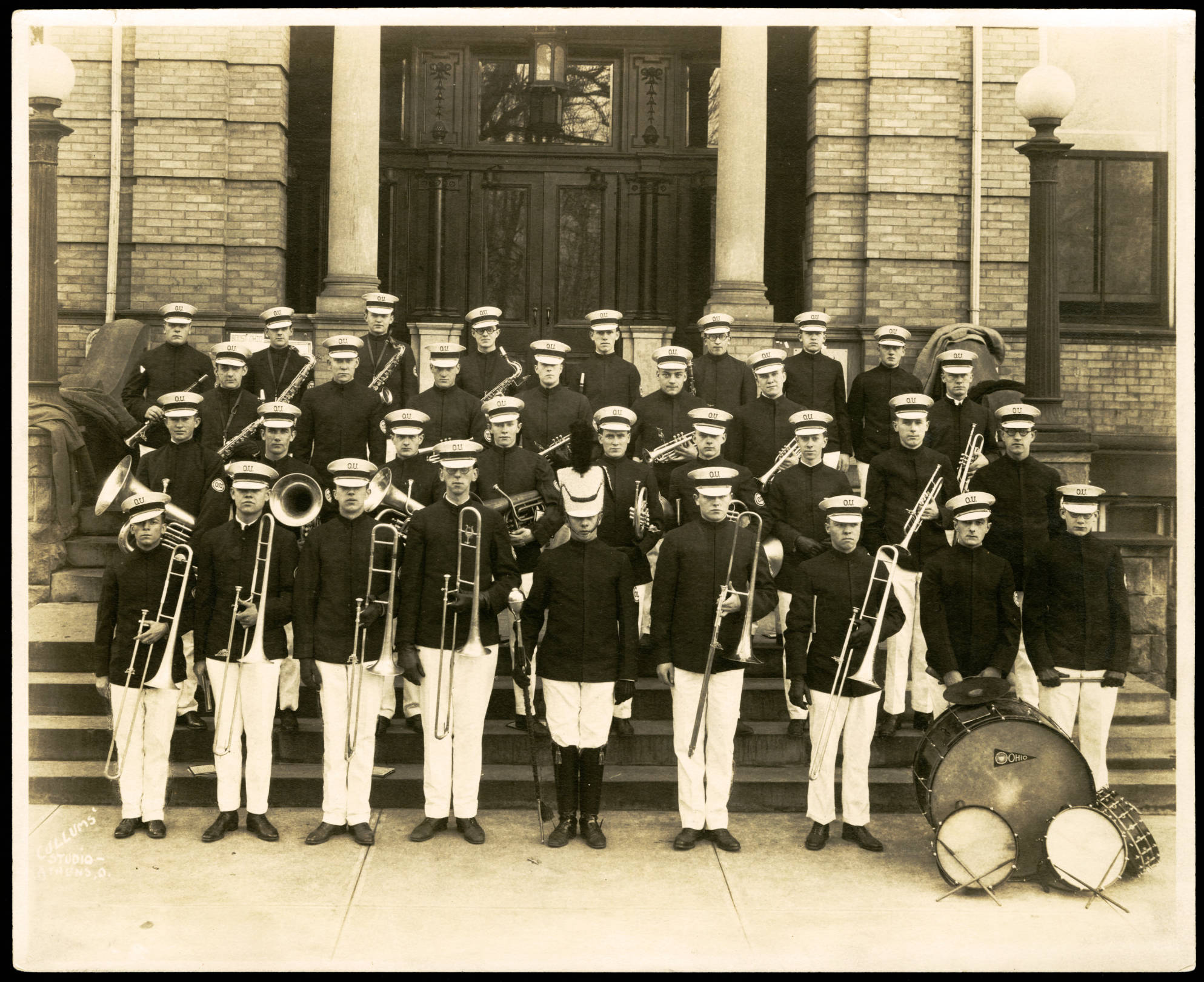Ohio University's first ever band stands on the steps of Ewing Hall in 1923. The original band of 33 members has grown into today, a group of 200+.(COURTESY OF OHIO UNIVERSITY LIBRARY DIGITAL COLLECTION)
