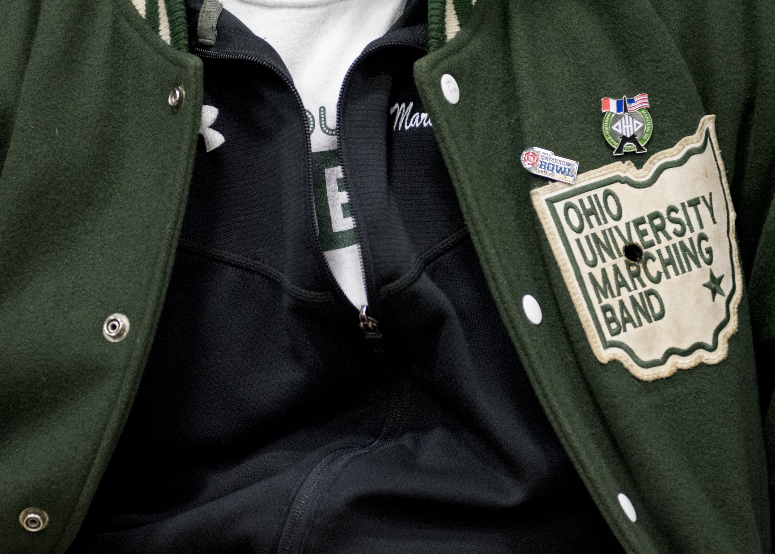 When a band member receives their 110 jacket, it's customary to burn a hole into the area of Ohio where you're from. If not from Ohio, members will burn a hole wherever their hometown is relative to Ohio.