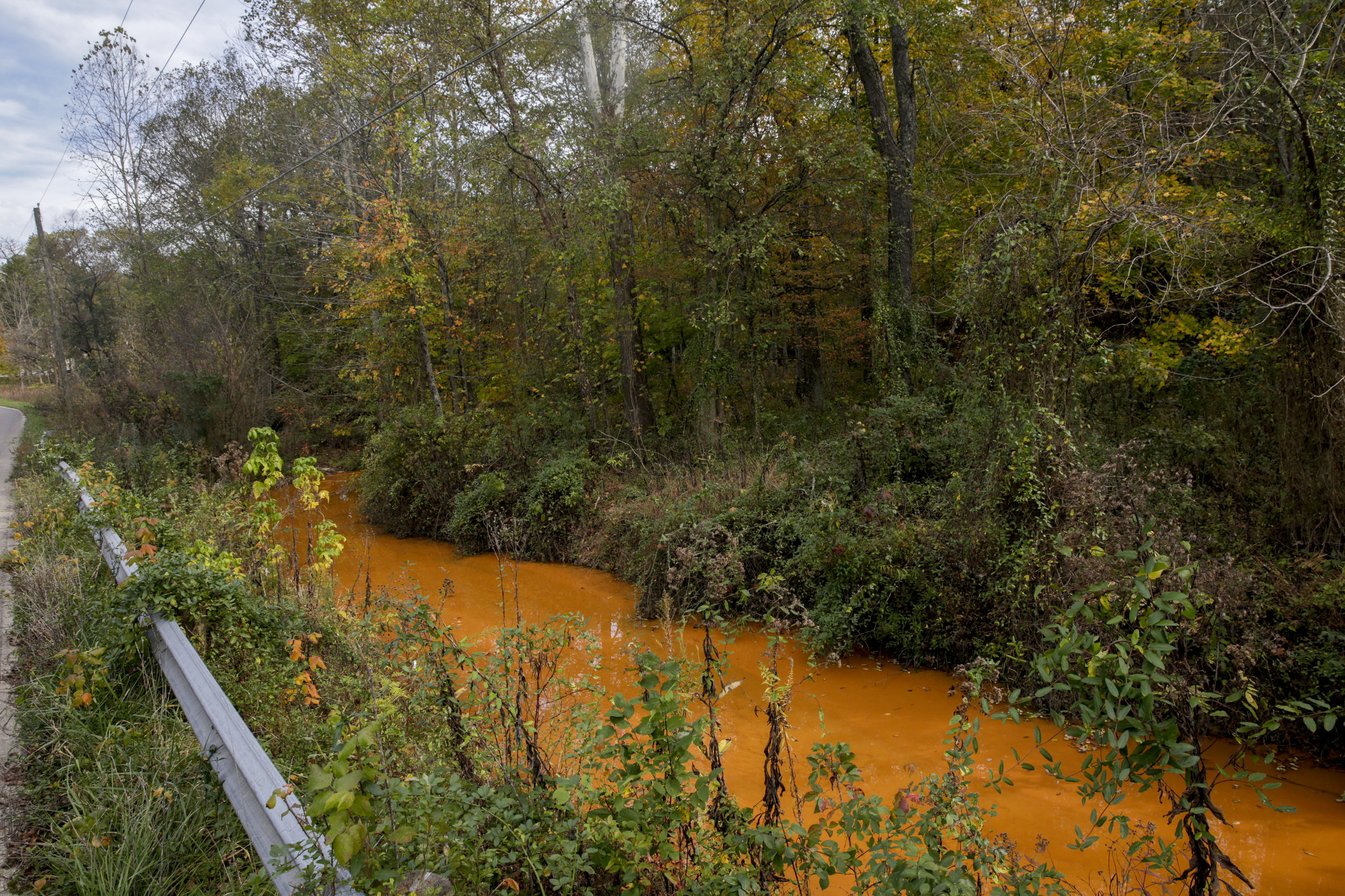 Hewett Fork is located in the unincorporated community of Carbondale in Waterloo Township in western Athens County. Polluted water flows out of a mine and goes through a mineral doser before entering the creek. Mining began in Carbondale in 1867, with all remaining coal mines closing years ago.