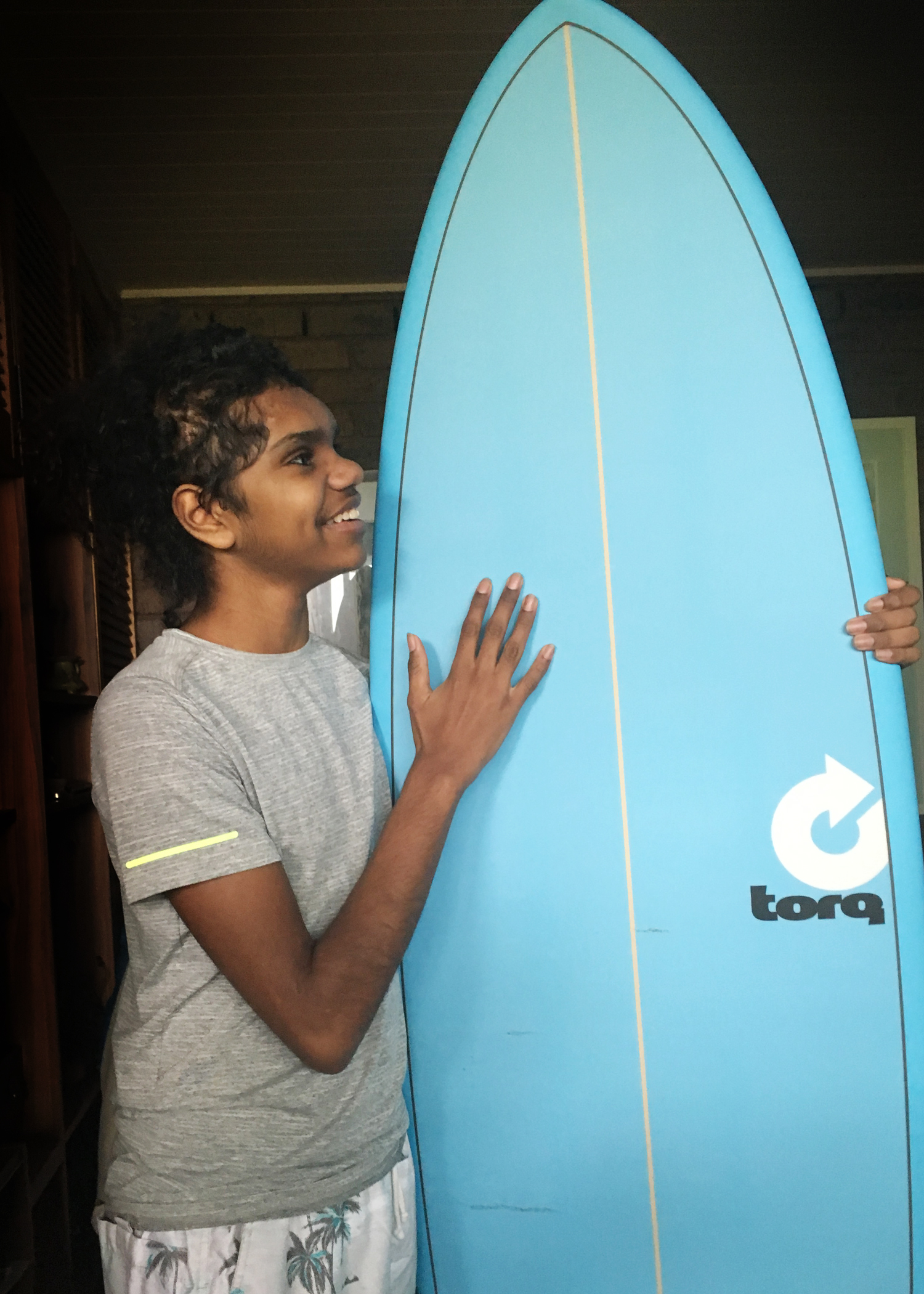 Cebby still plans to ride the surfboard he got for his 14th birthday.