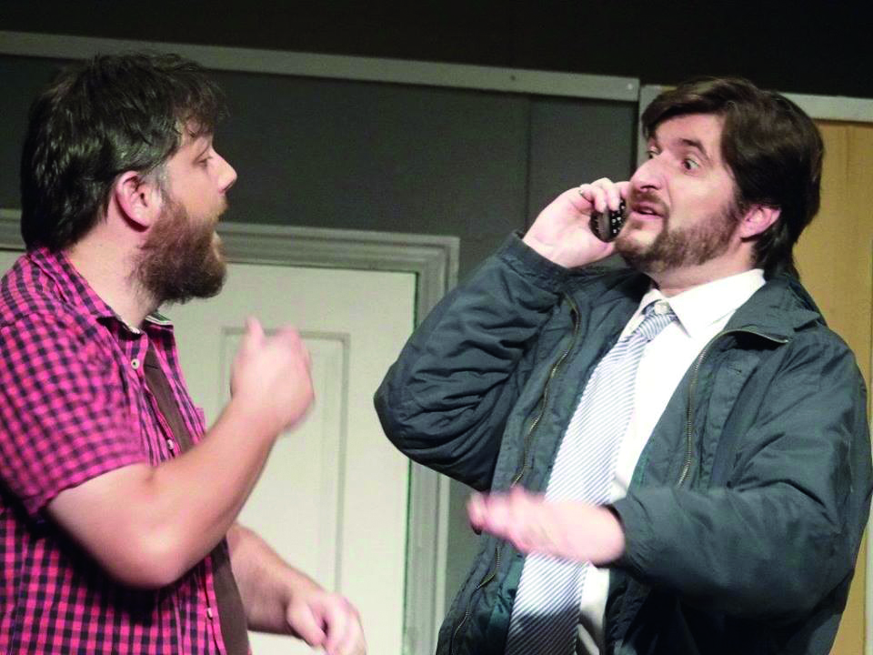 Rob Lister, as Pierce, and Mark Moore, as Parkes, in a scene from Caravan.