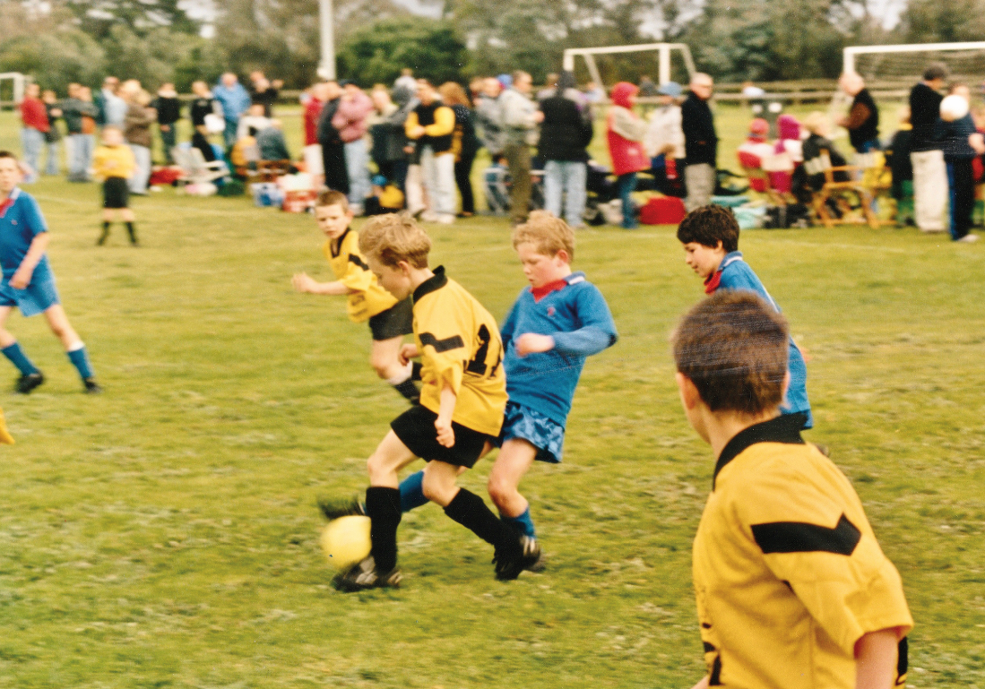 Young Tiger Cameron Howe manoeuvres the ball past a Langwarrin opponent. Cameron's No.11 shirt is one of the items Seaford United will be donating to an East Timor sister club.