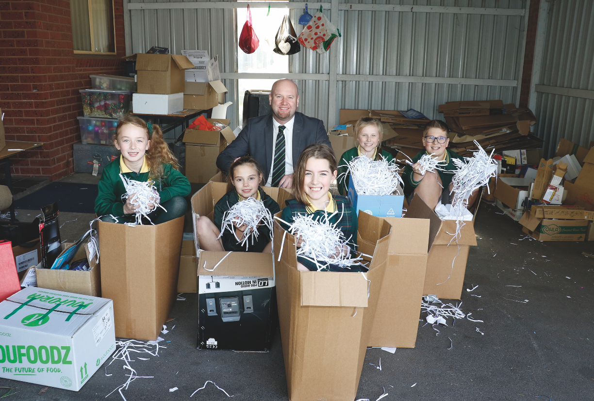 Frankston City Mayor Michael O'Reilly visited St Jude's Primary School in Langwarrin to congratulate the proud Mini Vinnies. From left to right, the children are Keira (grade 3), Lily (grade 3), Ryleigh (grade 3), Erica (grade five) and River (grade 6).