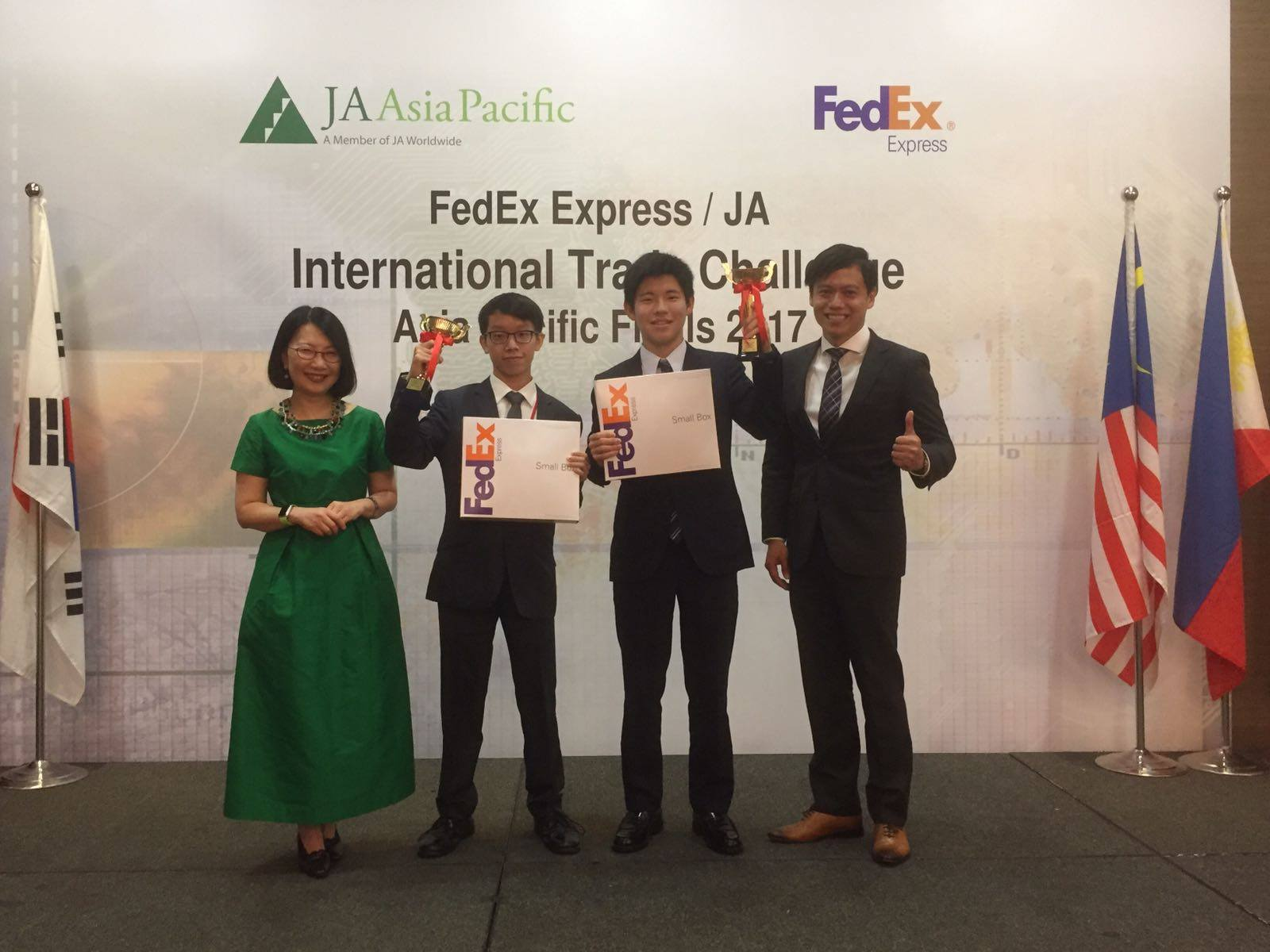The third-prize winner is Team Collera: Kevin Ho from Hong Kong (second from left) and Taishi Nishizawa from Japan (second from right).