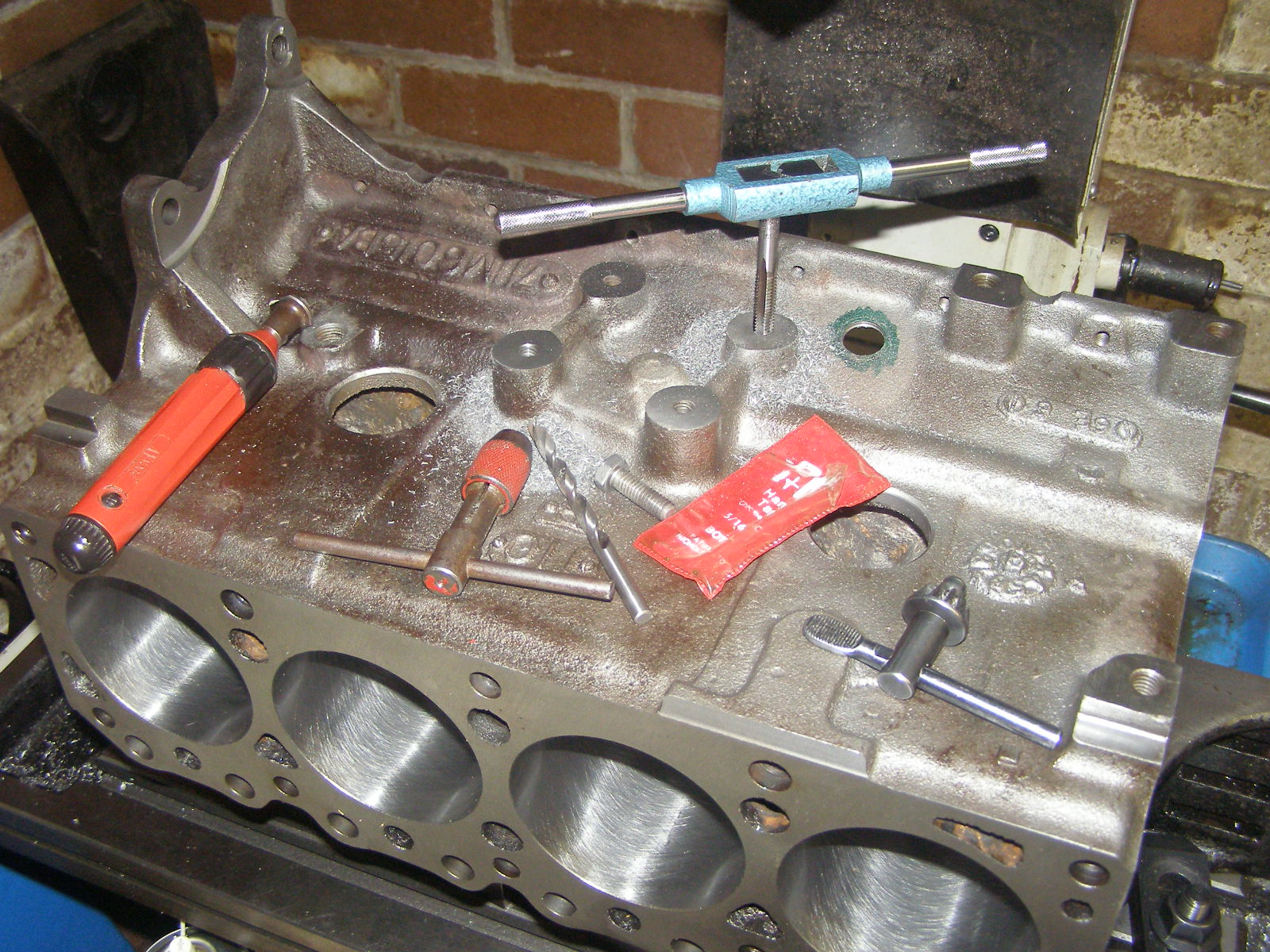 """Increasing depth of LHS engine mount attach threads in freshly bored, decked and line-bored 711M block after removal of 0.450"""" from LHS engine mount pad to bring transverse block width in to line with that of earlier 120E, 116E, 691M et al pre 711M blocks."""