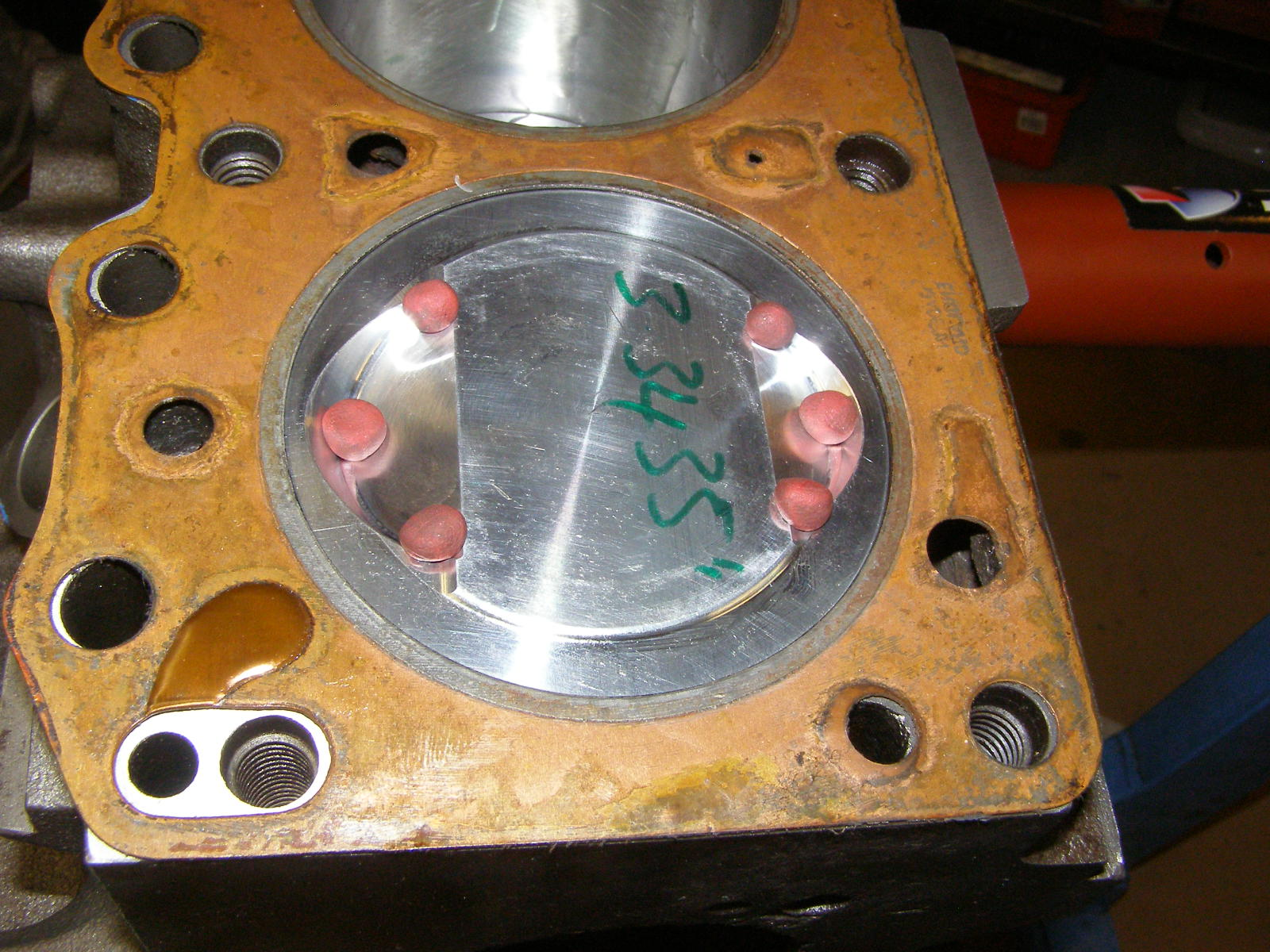 Clay blobs waiting patiently to be squashed during valve to piston clearance check...