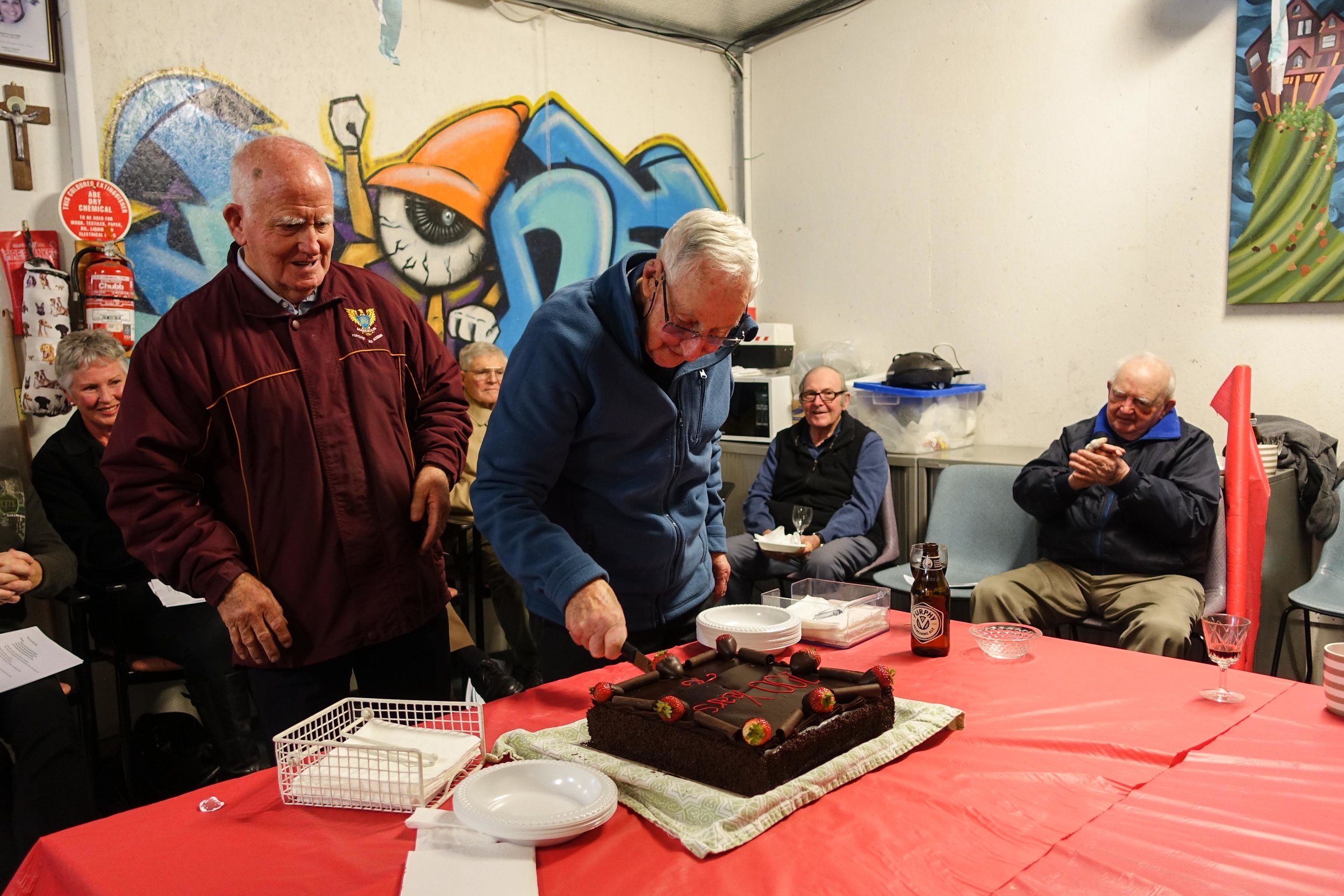 Oldest Brother present cuts cake - Br. Brendan Feehan with Br. Doug Walsh