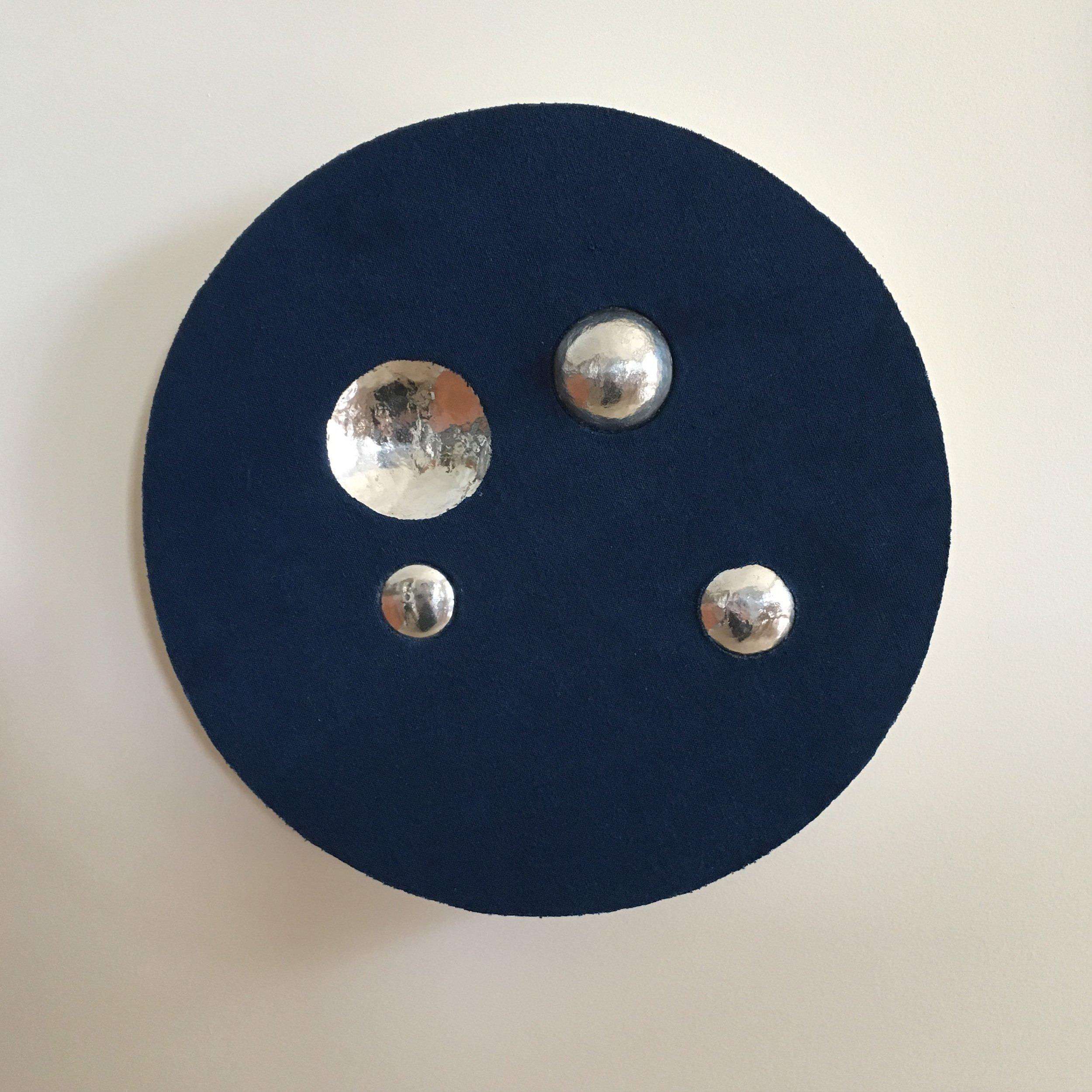 Indigo spaces between reflecting    Indigo dyed cotton mounted onto layered plywood with aluminium385 x 385 x 70
