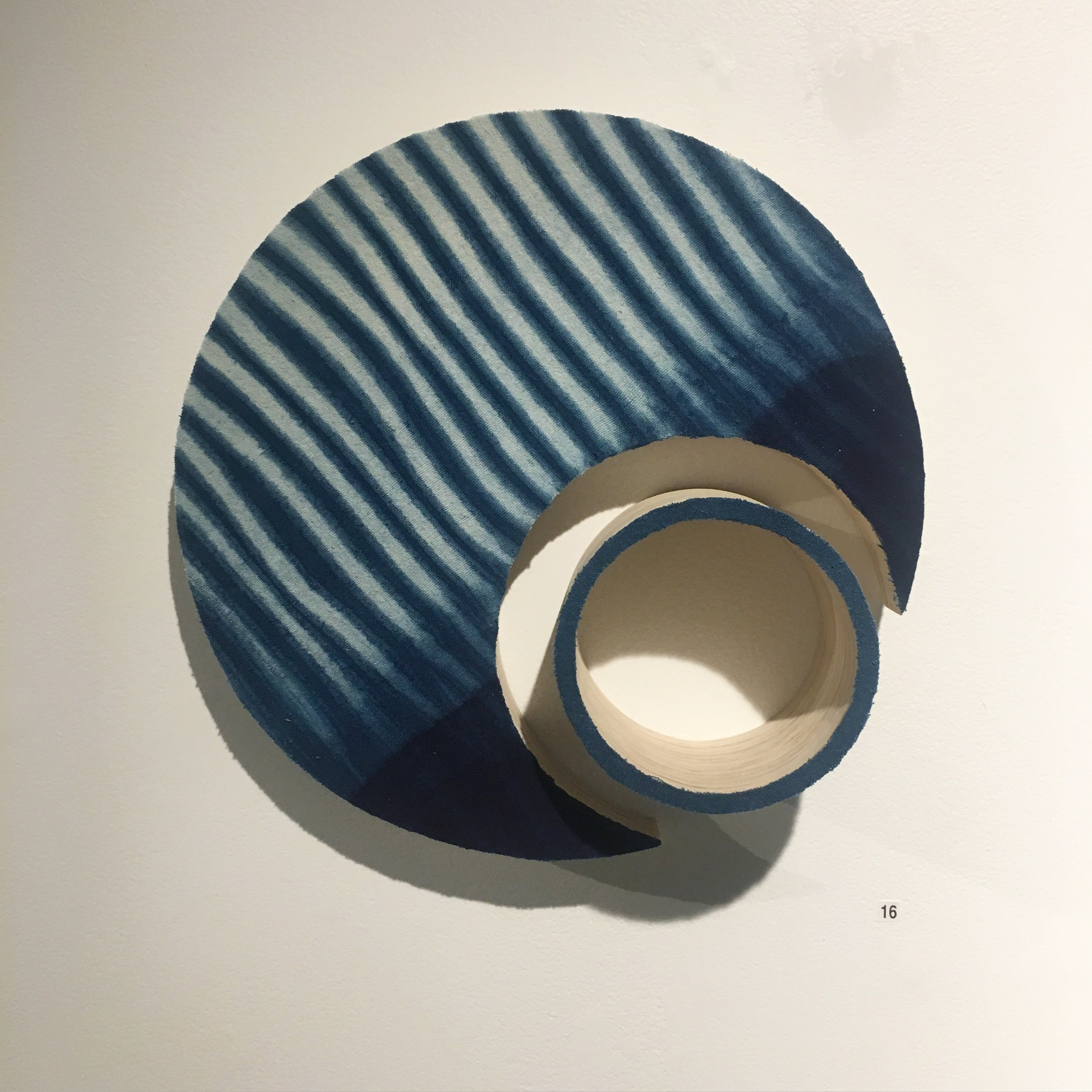 Indigo into the void and split    Indigo dyed linen mounted onto layered plywood 360 x 360 x 100