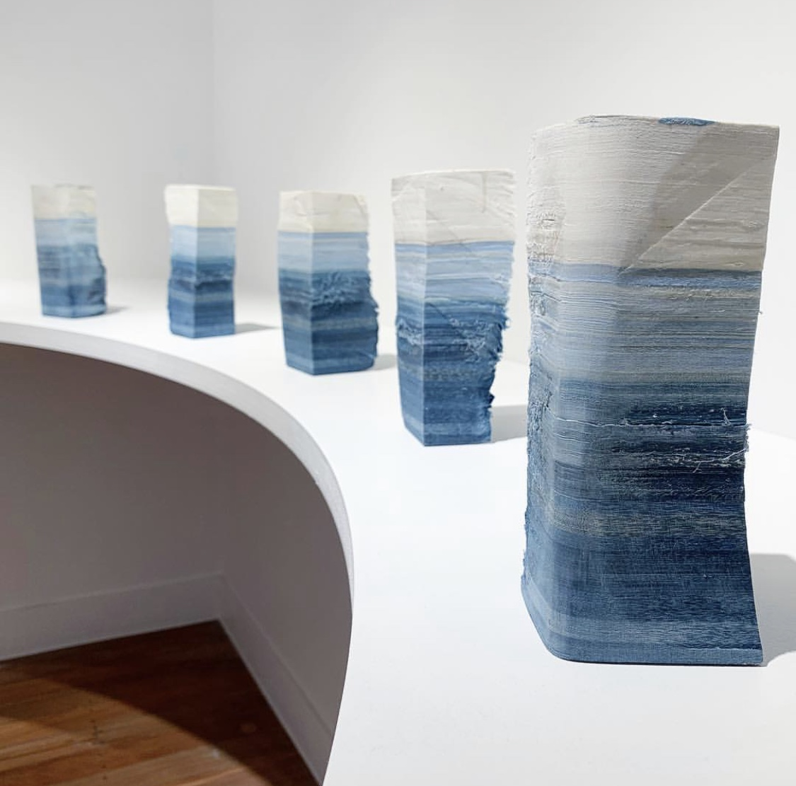 Recuperated Material Monuments, 2018.   Indigo dyed, layered, salvaged textiles (bedsheets). Installation Image: Rachael Wellisch.