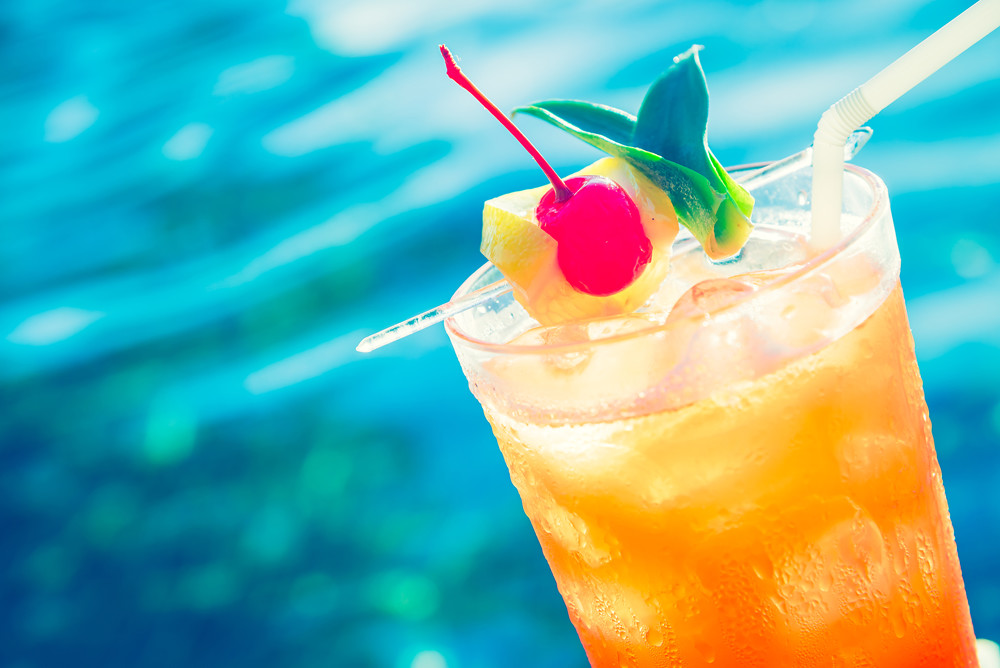 stock-photo-fruit-cocktail-glass-at-pool-vintage-filter-effect-284847011.jpg