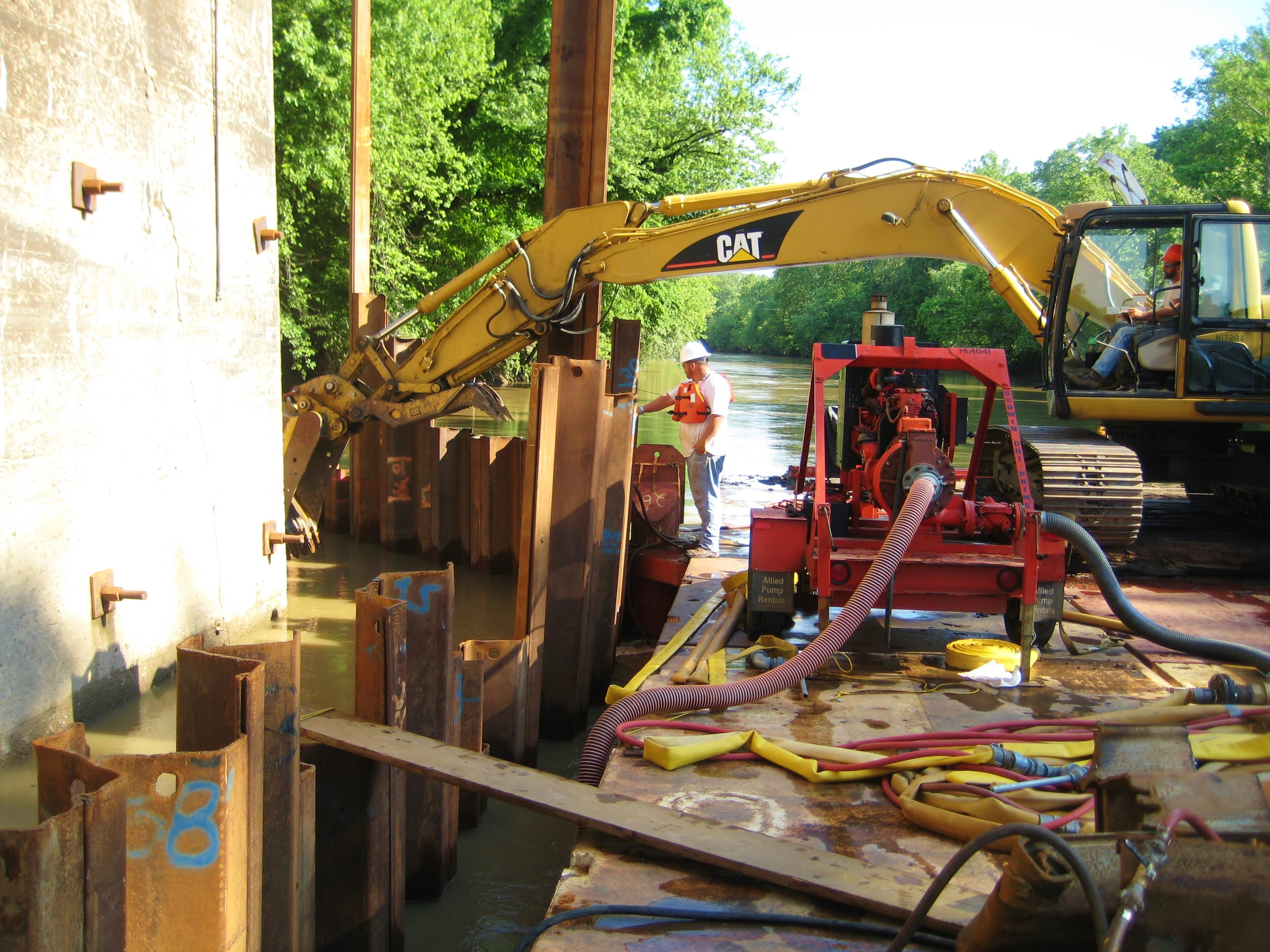 Bridge footer debris removal