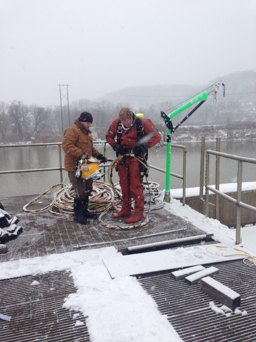 ES-Divers preparing to enter clarifier pool using helmet-mounted video and full-sealed vulcanized dry suit.