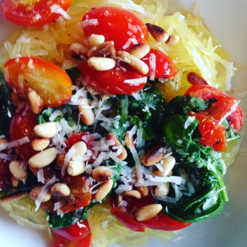 Spaghetti squash with tomatoes, spinach and pine nuts.