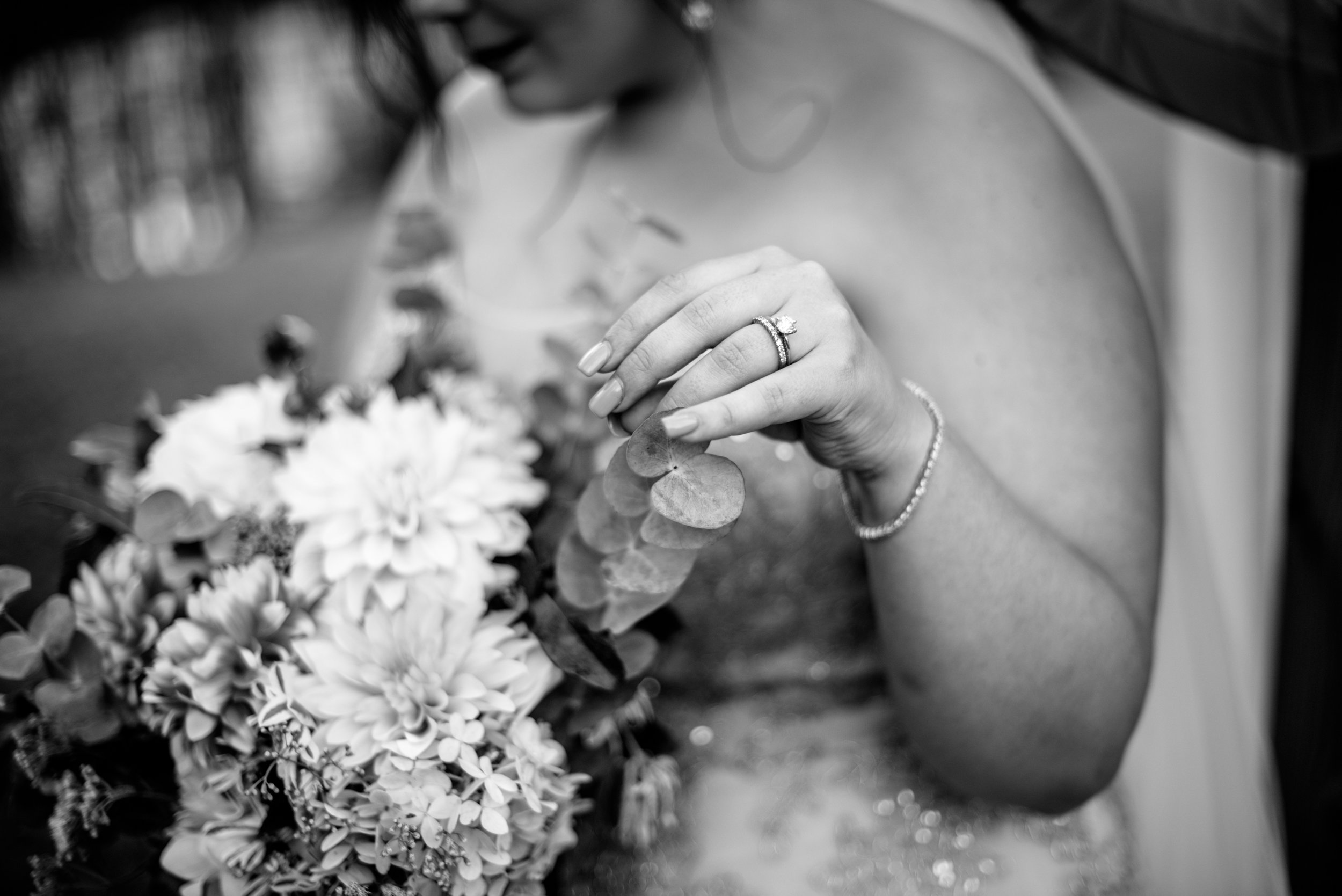 bride enjoys romantic wedding bouquet with rings