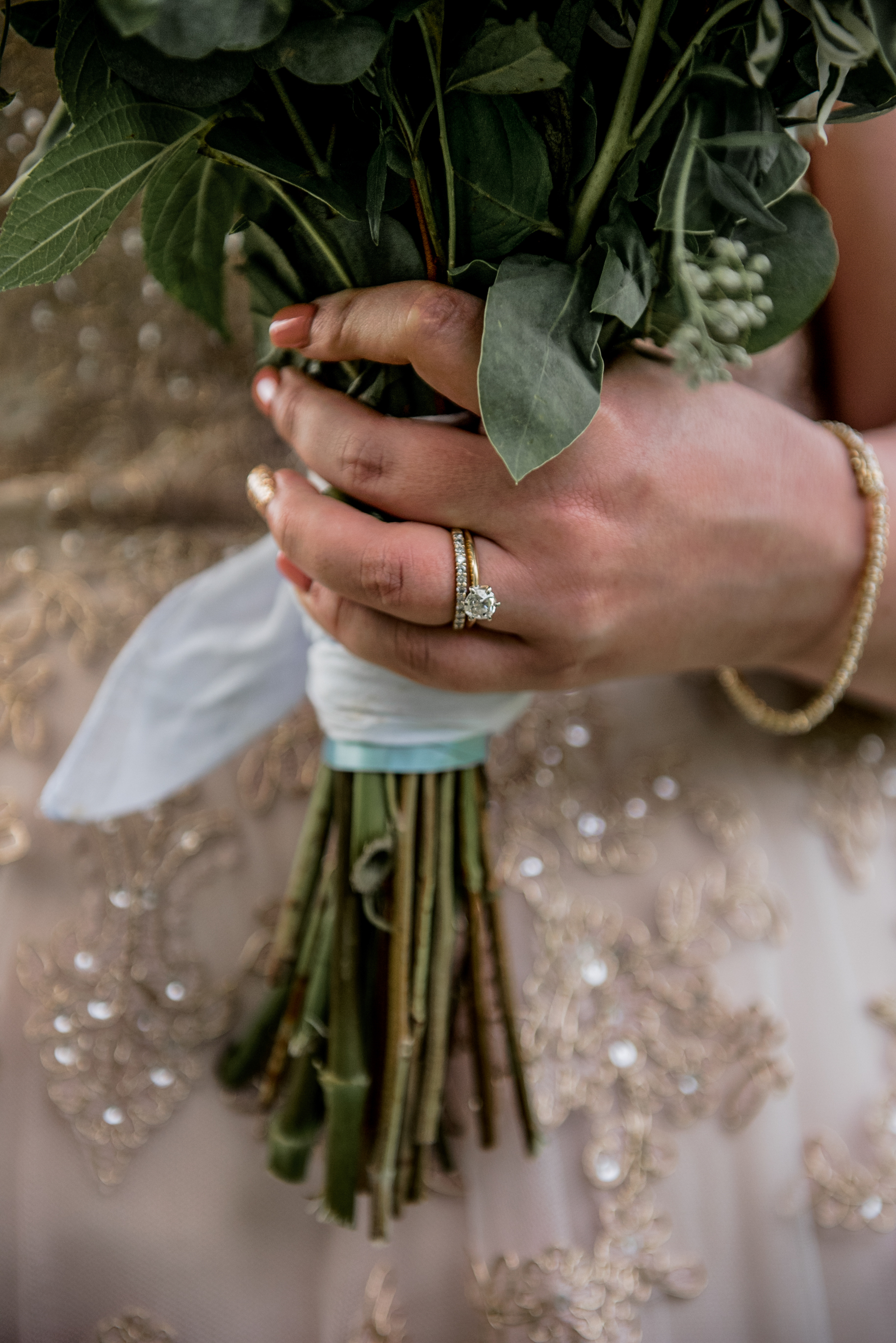 brides rings while holding bouquet