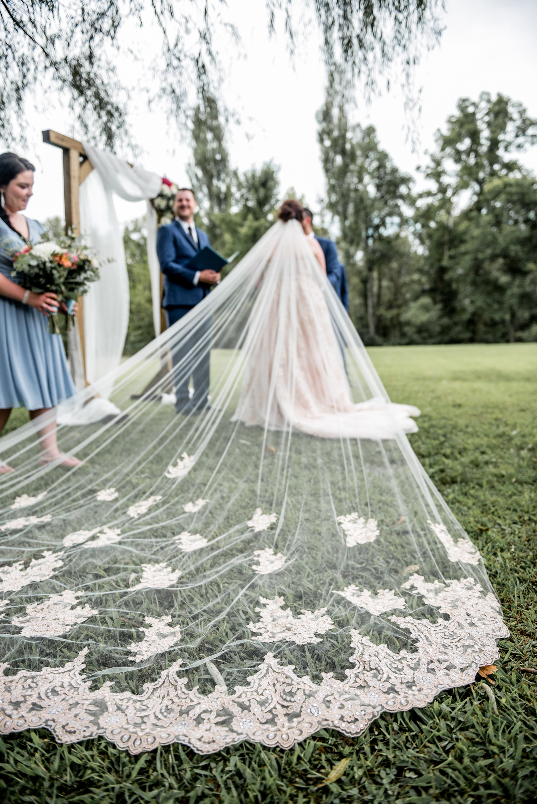 cathedral veil draped behind bride