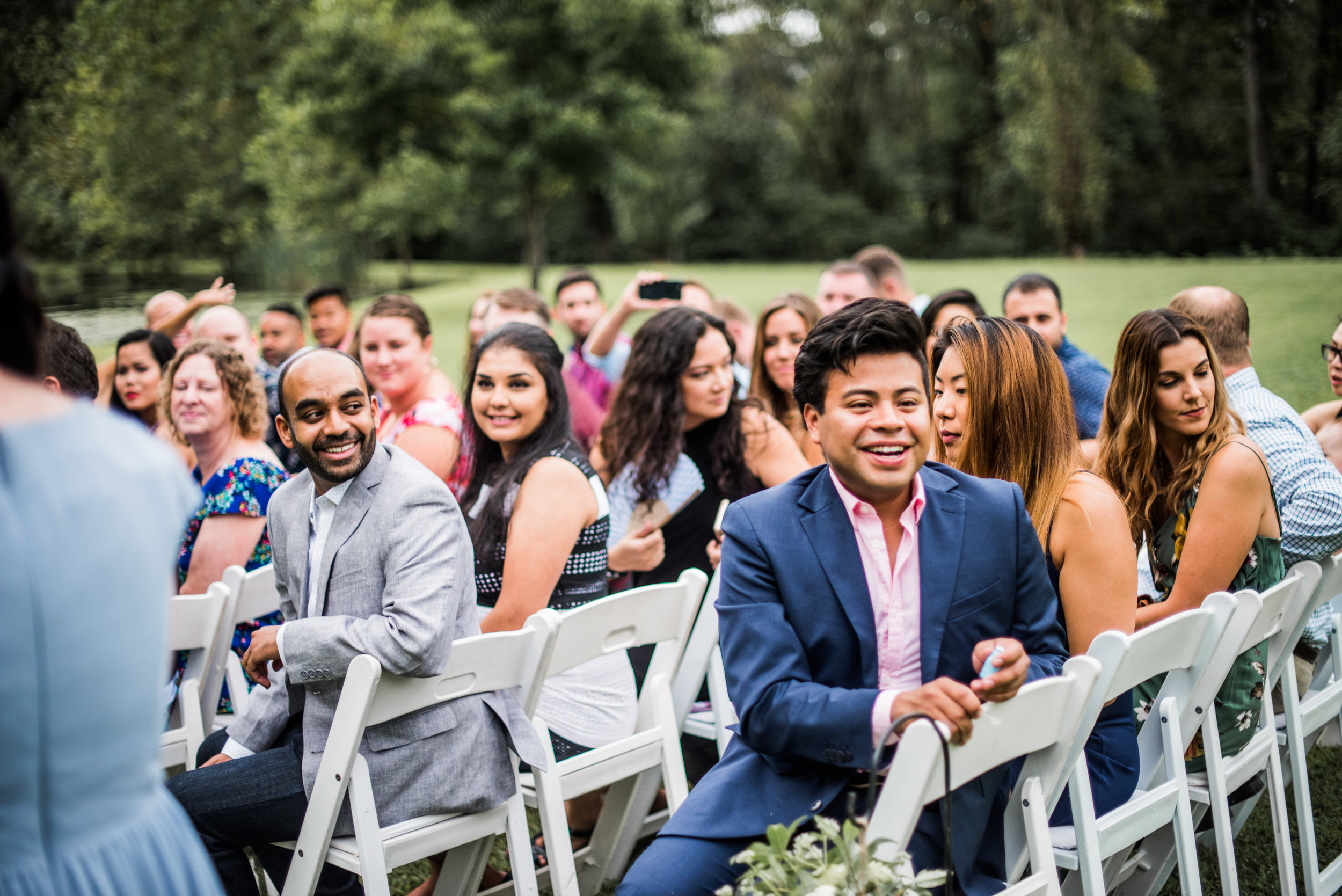 emotional guests watch bride walk down aisle