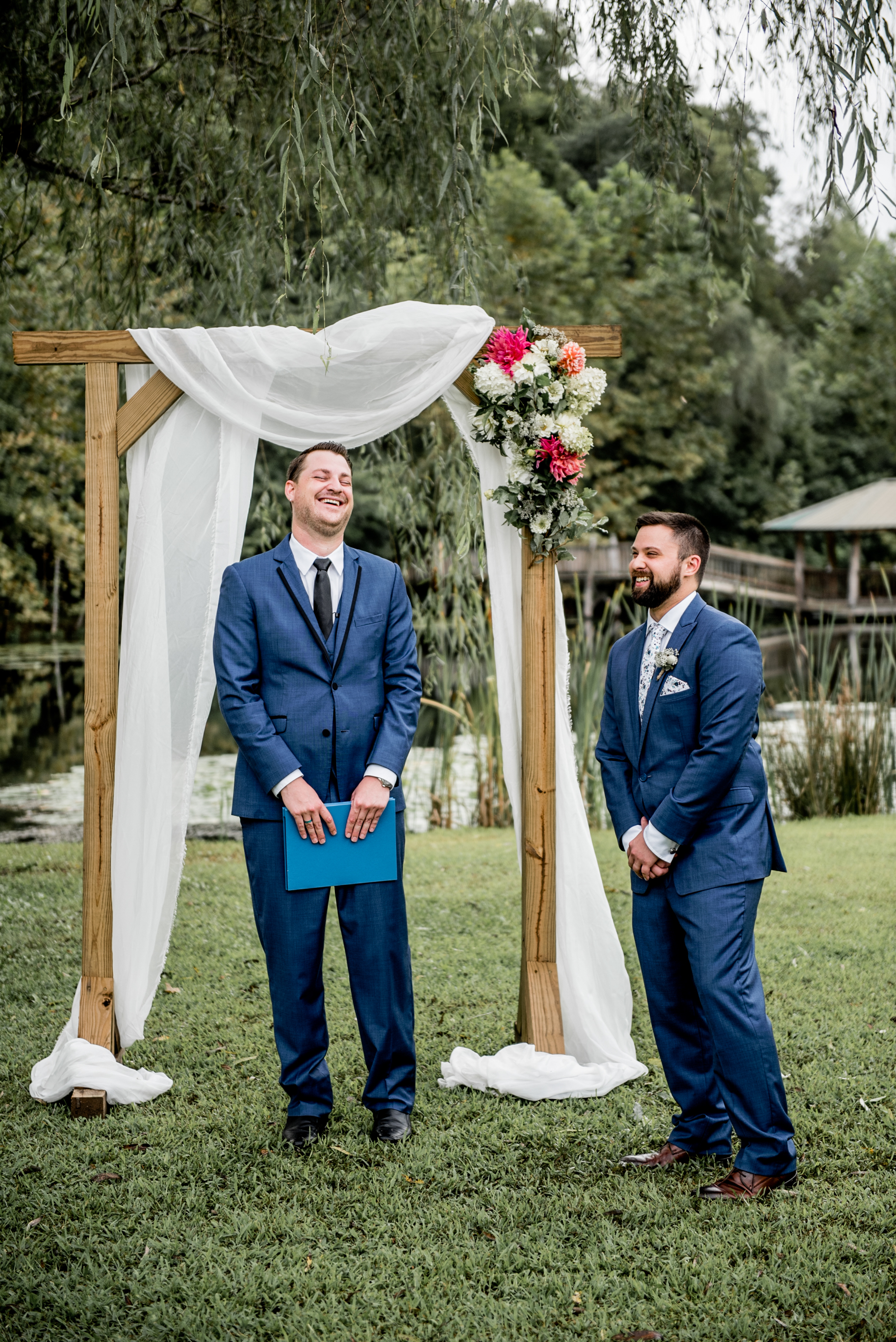 Groom and officiant laugh