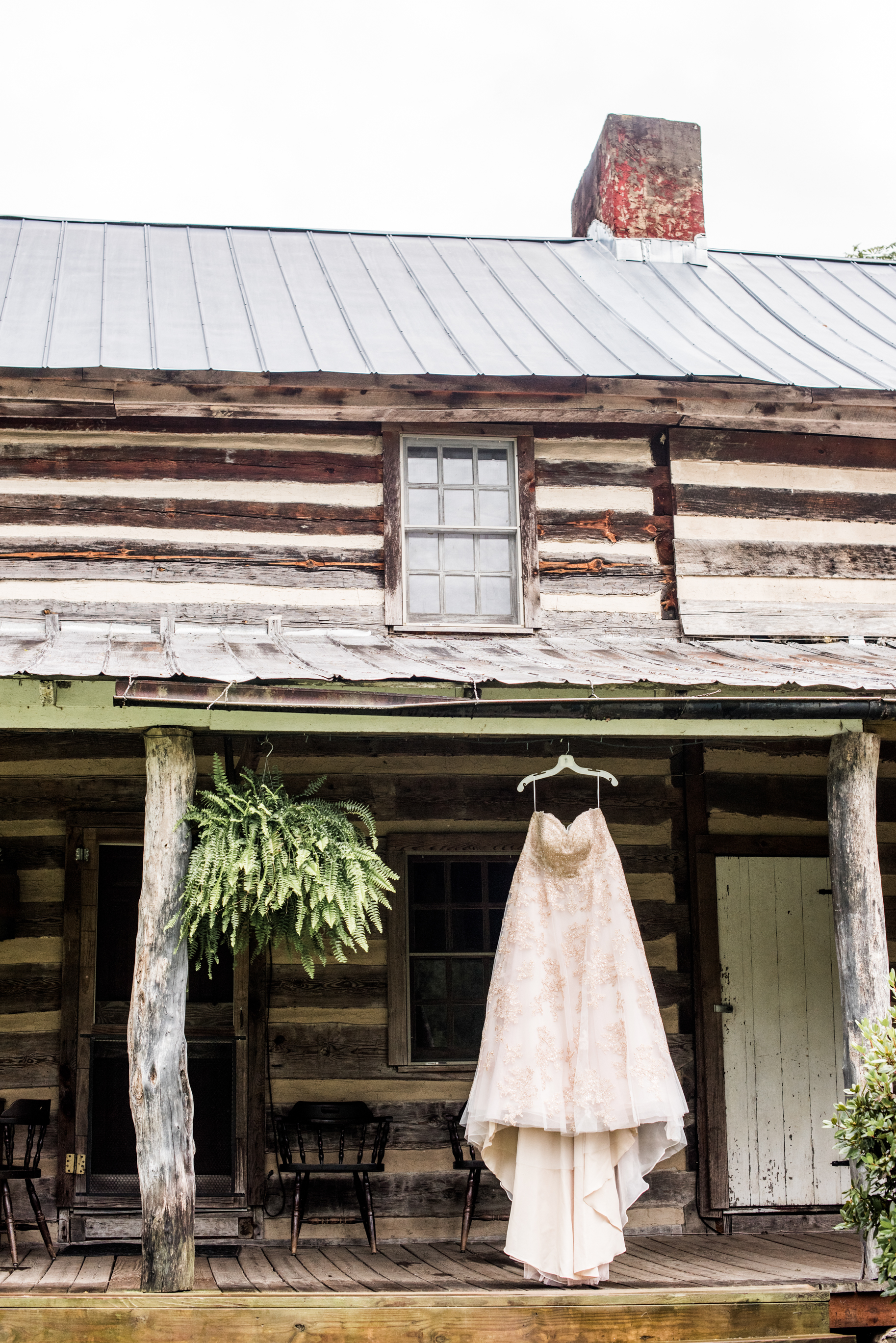Romantic rustic wedding gown cabin lodge