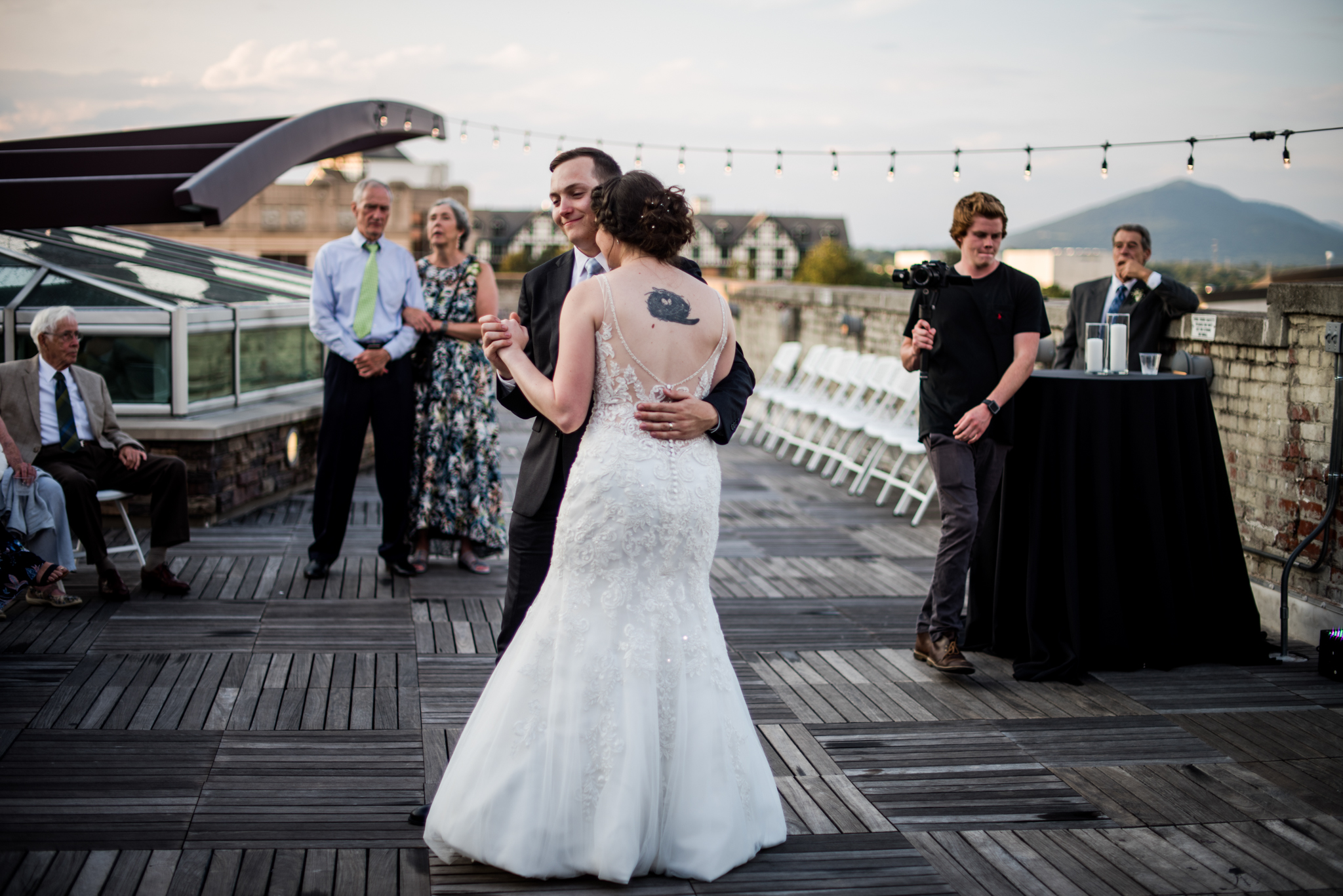 bride and groom first dance on downtown roanoke rooftop