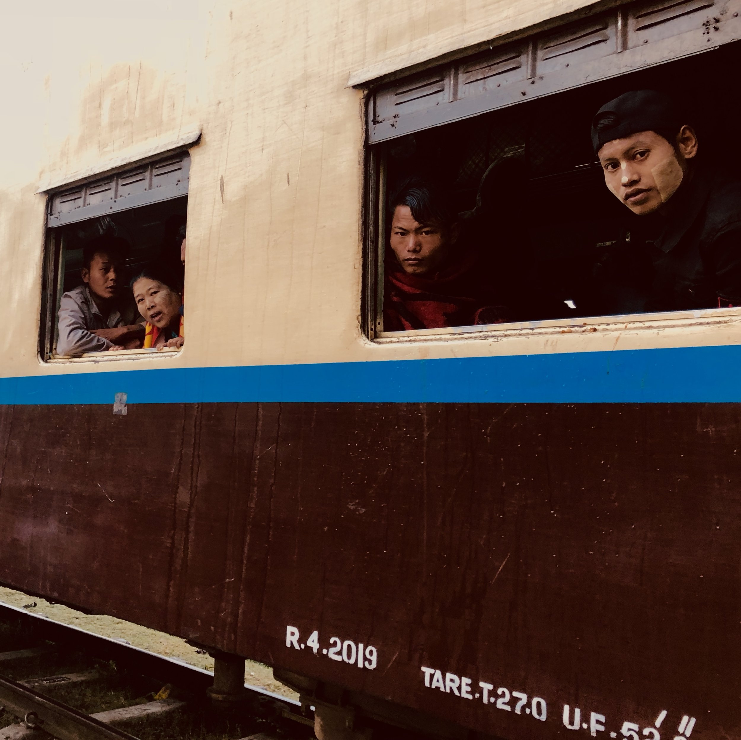 Passengers wait for the train to depart