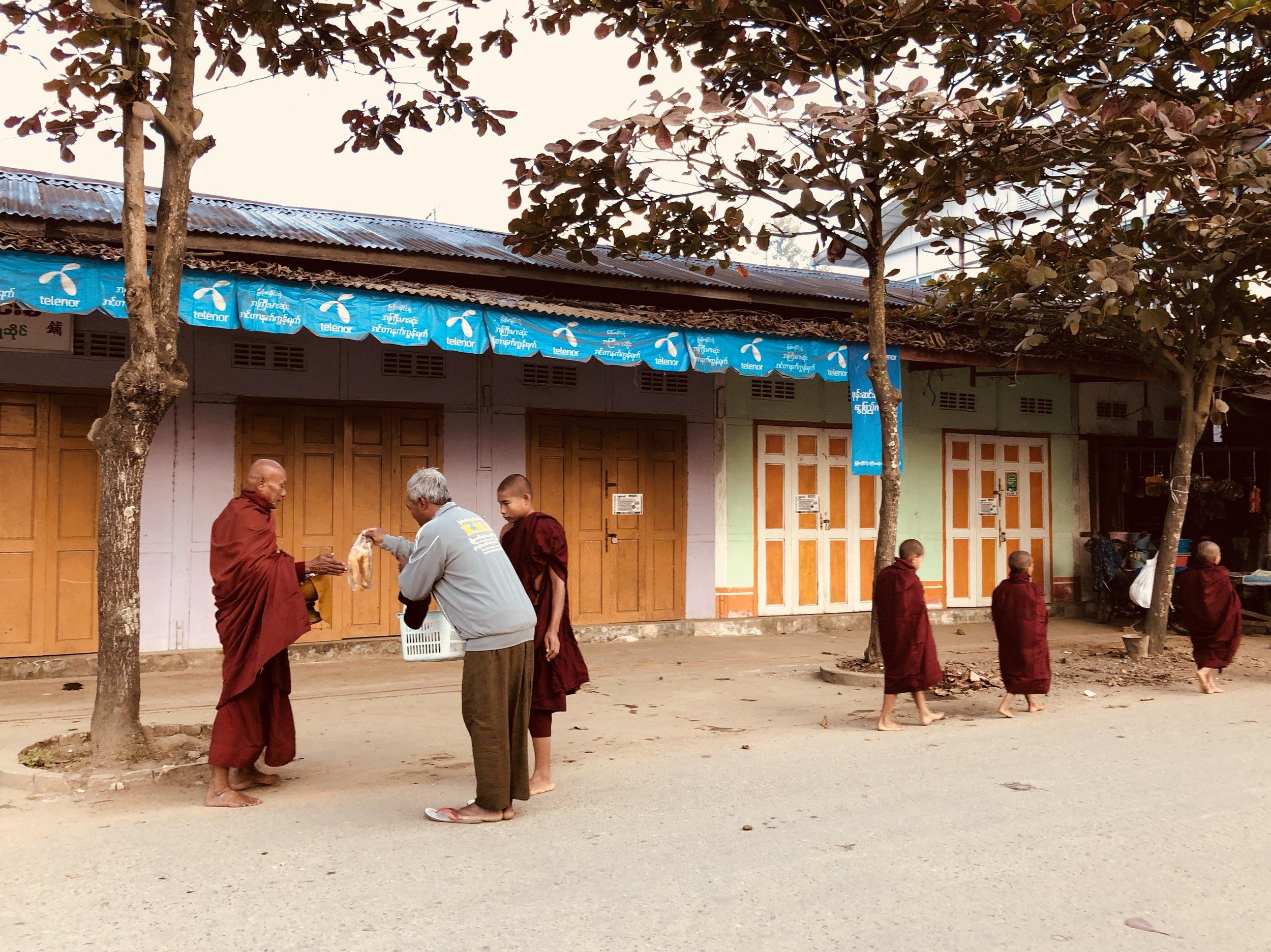 Monks receiving alms in Hopin