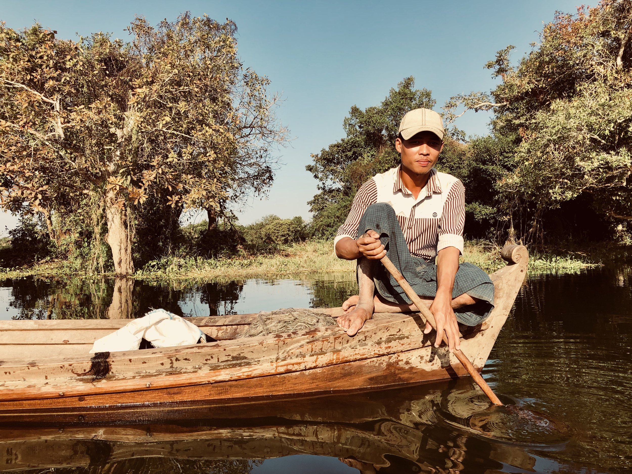 Local fishermen cast their nets