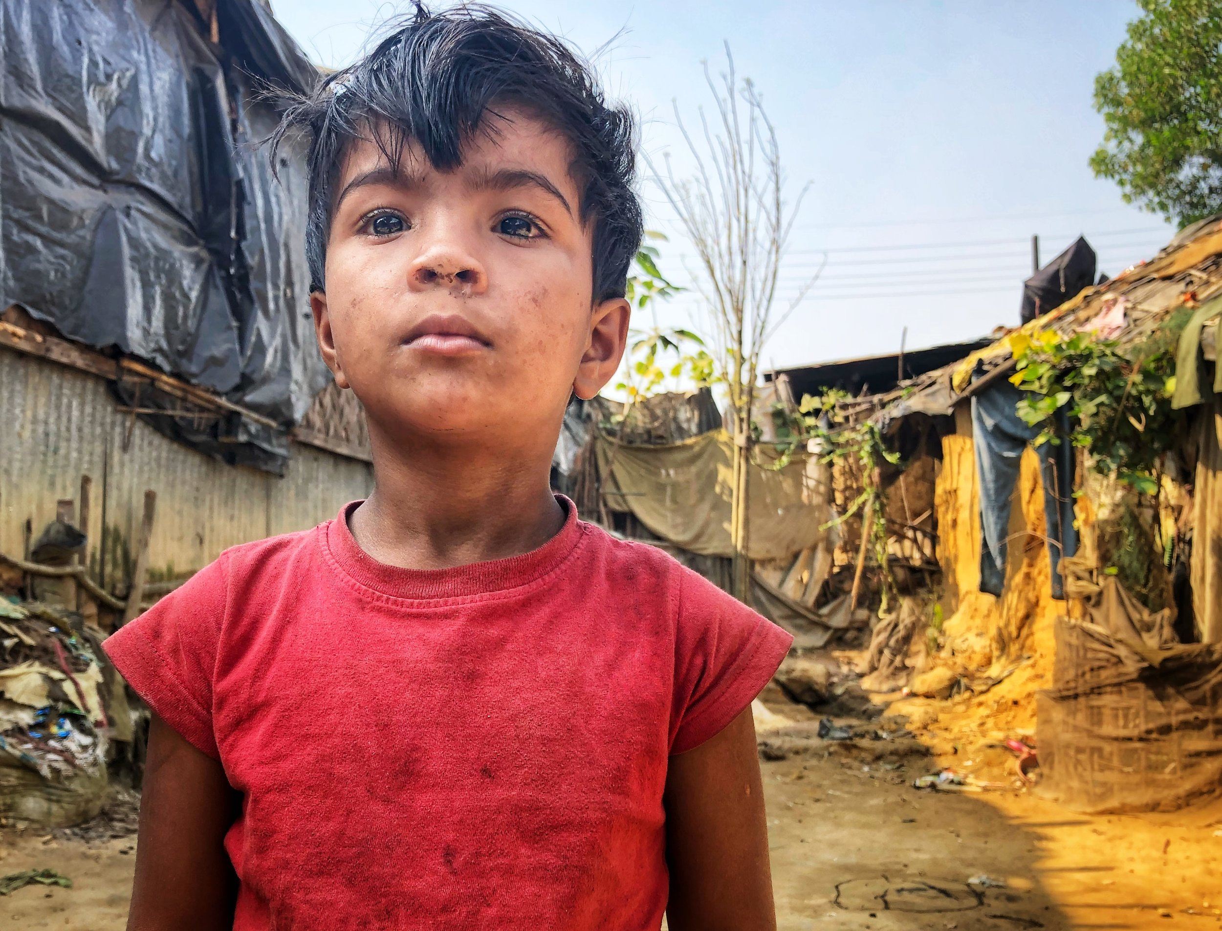 A young boy at the Koutopalong Refugee Camp in southern Bangladesh. Over 60% (or half a million) of all refugees are under 18.