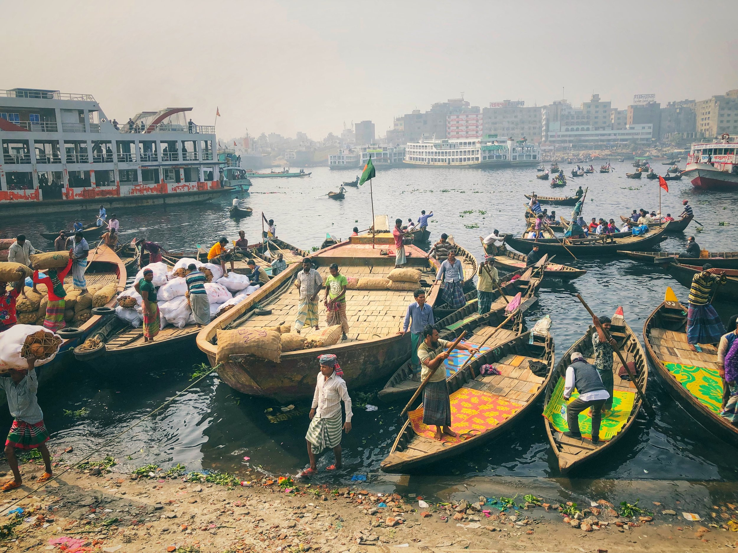 An astonishing, almost biblical scene on the banks of the Old Ganges, Dhaka. The sheer volume of boats was a sight to behold. The stench of fabric dye and the inky blue waters are caused by uncontrolled dumping of waste from garment factories that line the river's shores.