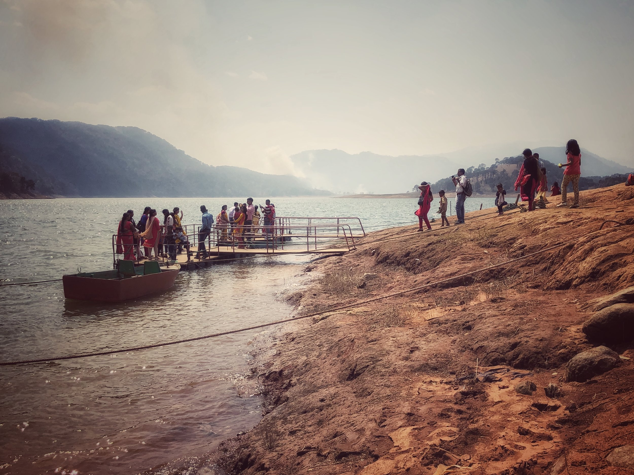 Indian tourists at Umiam Lake (with added slash-and-burn)