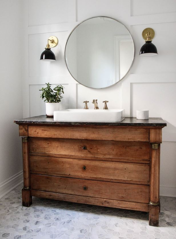 Antique console with contemporary round mirror, contemporary tiles and lighting