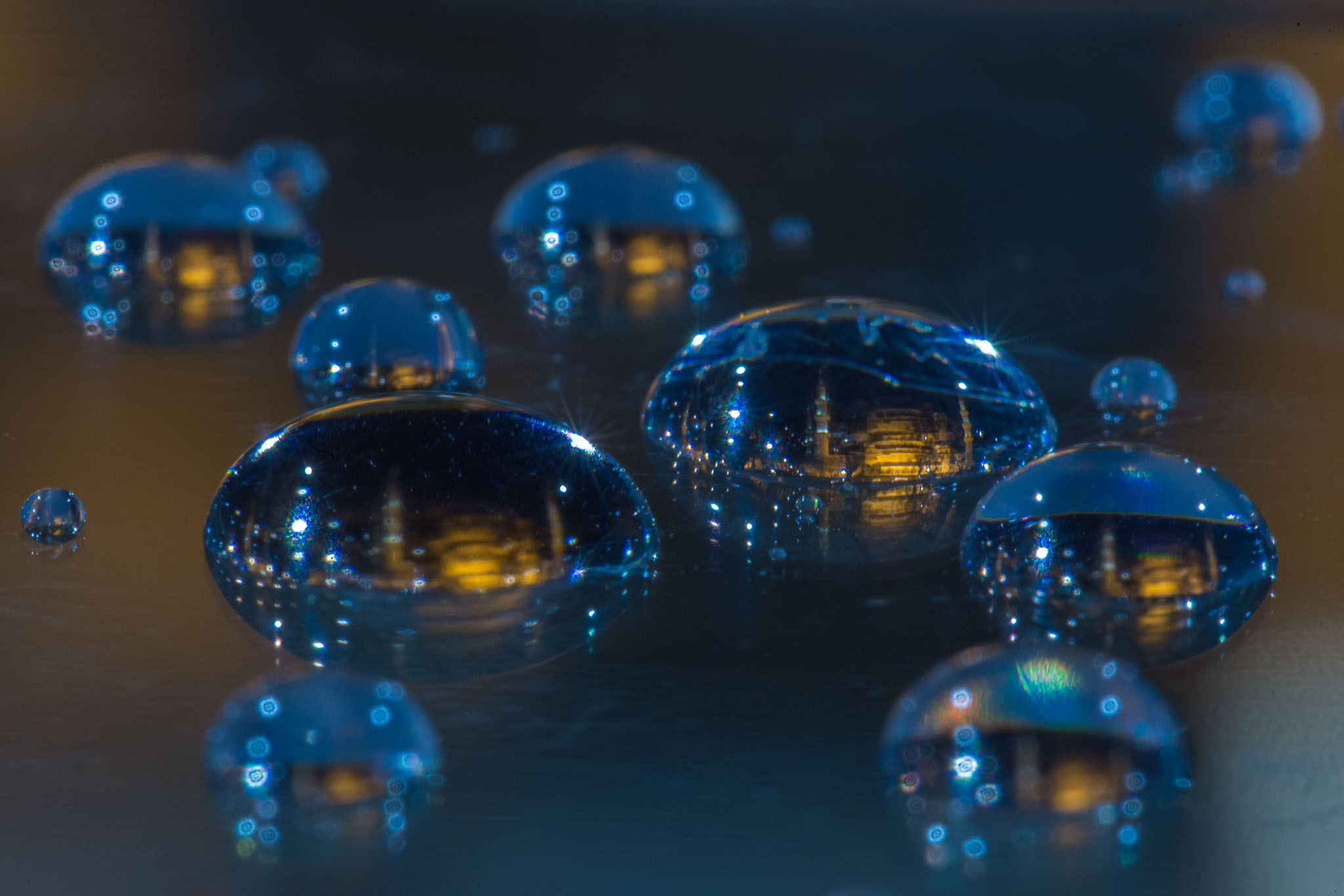 Macro photography project shows cities captures in tiny drops of water - Lonely Planet Travel News. Article by James Gabriel Martin. Photographs by Dusan Stojancevic