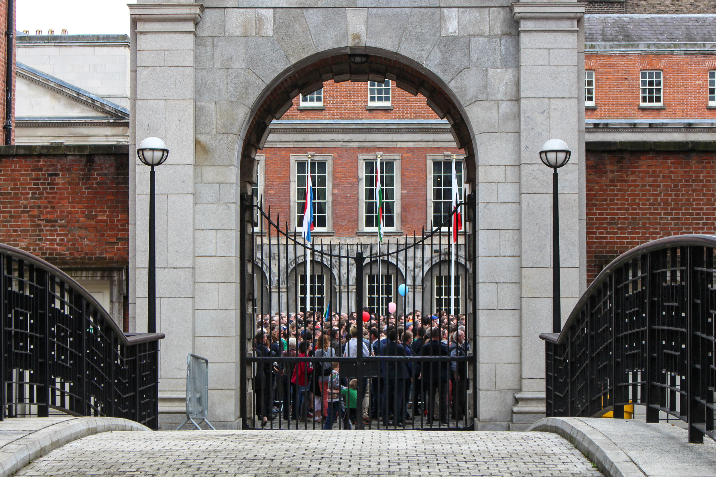 Crowds gathered inside the gates of Dublin Castle on May 23 as ballot boxes were emptied and votes were counted. Photograph by James Gabriel Martin