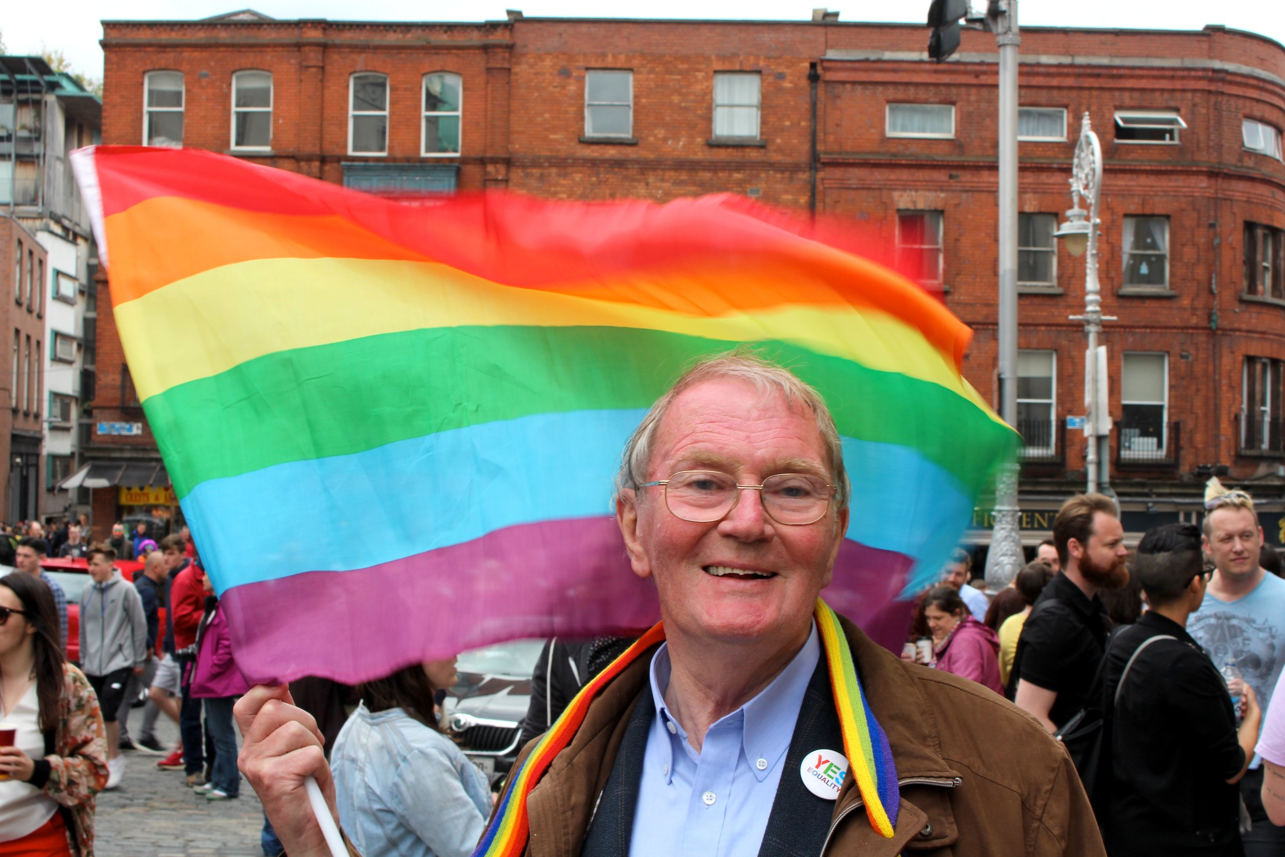 Eighty year-old Charlie Mooney was there with his daughter, and was proud to fly the rainbow flag. Photograph by James Gabriel Martin