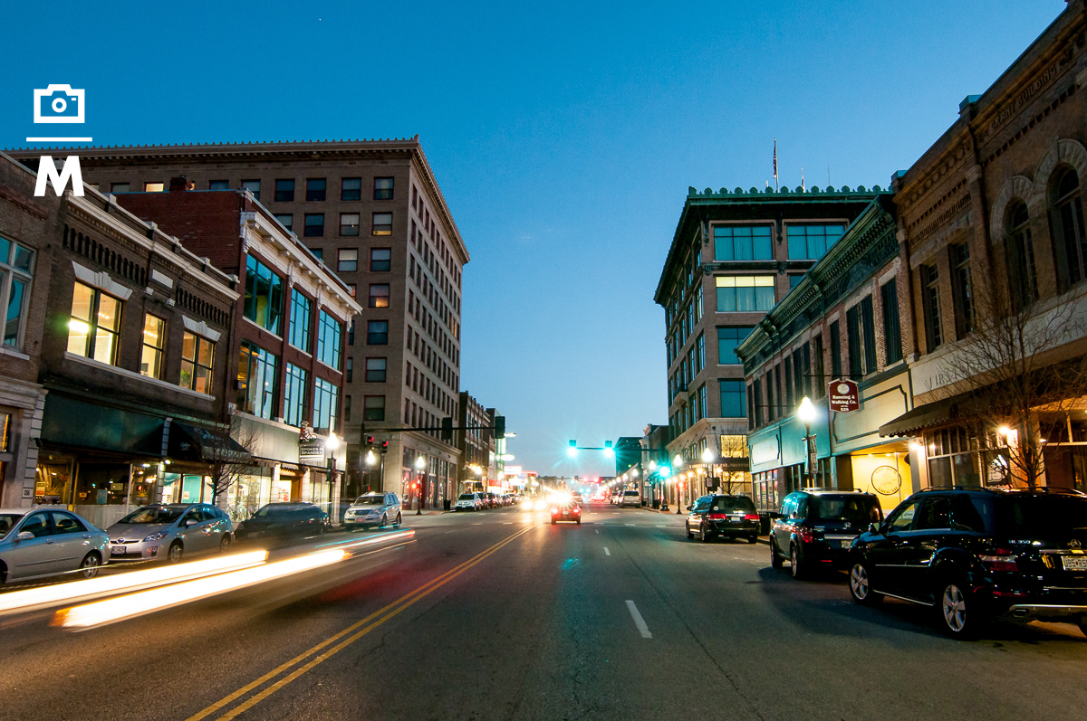 a variety of images on or near Main Street Joplin- day and night scenes.