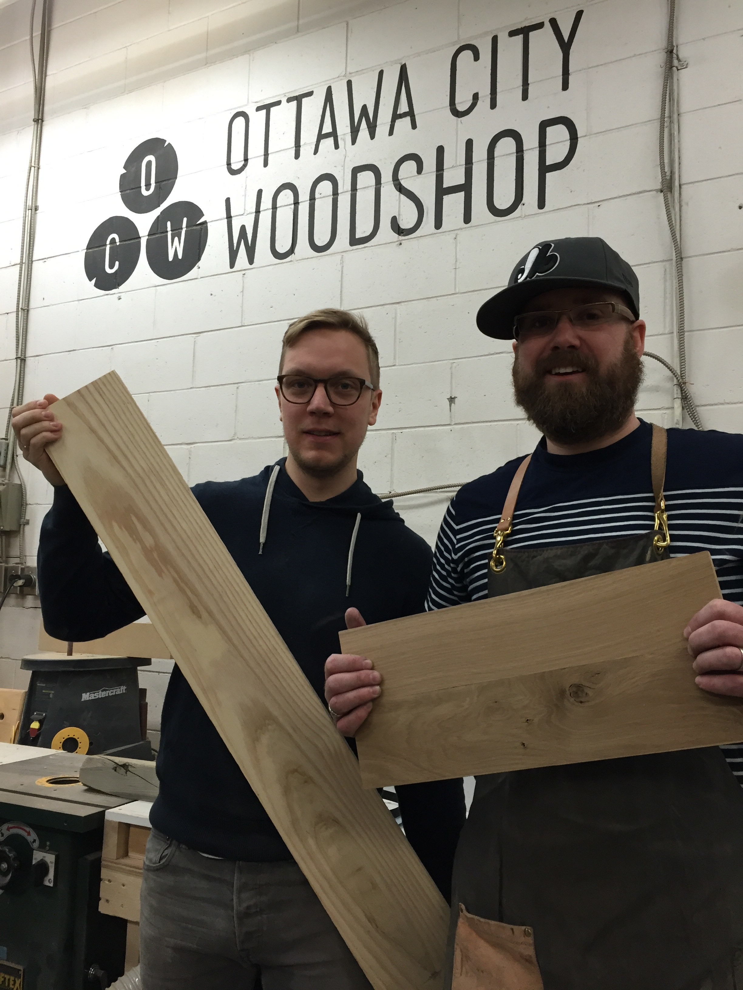 Mike Grigoriev (left) holding a piece of ash, and Matt Wallace (right) with a piece of white oak from the approximately 400 year old ash tree from Manotick.