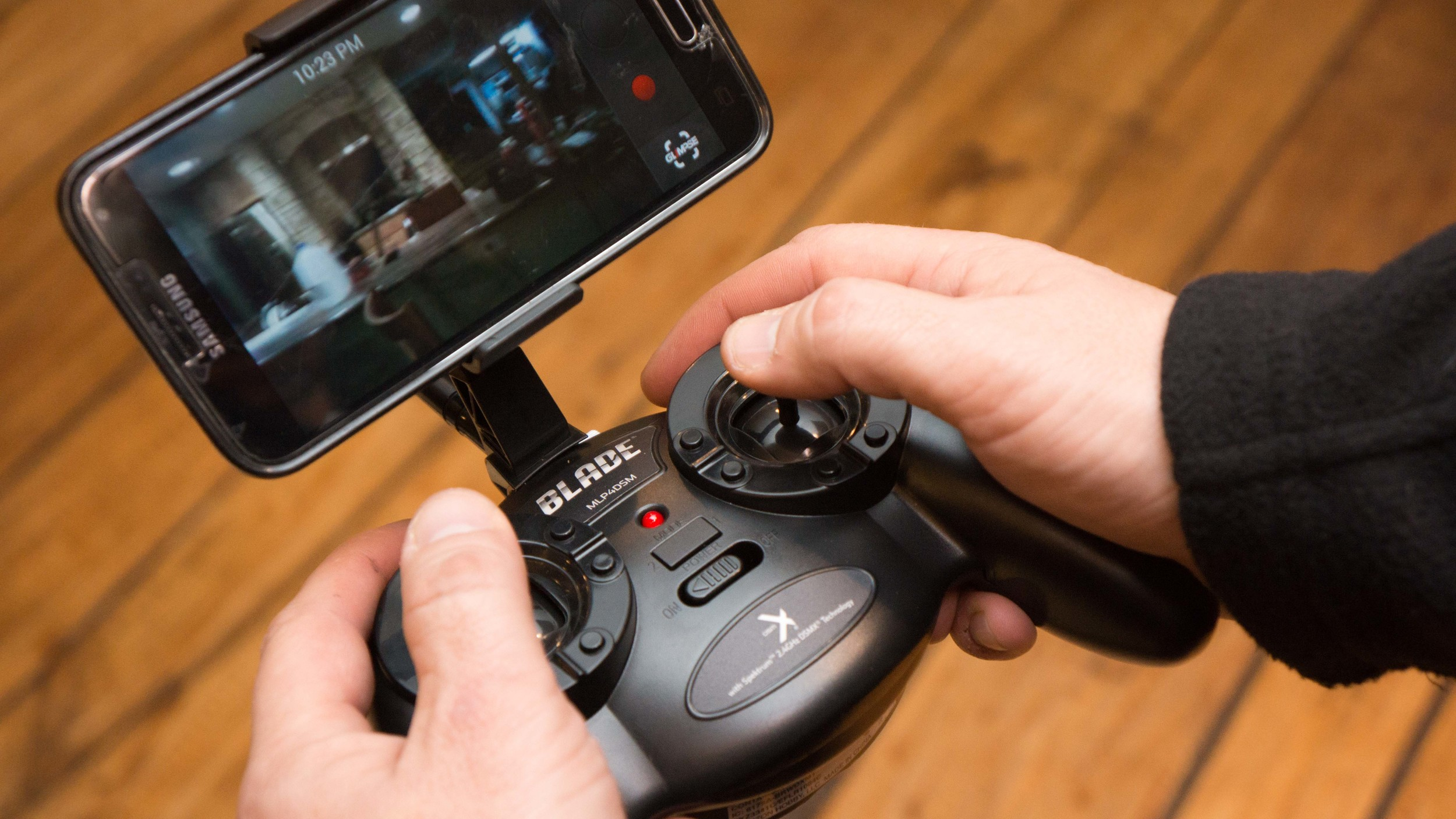 """Blade GLIMPSE FPV Quadcopter transmits video to an APP on your mobile device. The """"trim"""" tabs can be seen on the circular rim of the input sticks."""