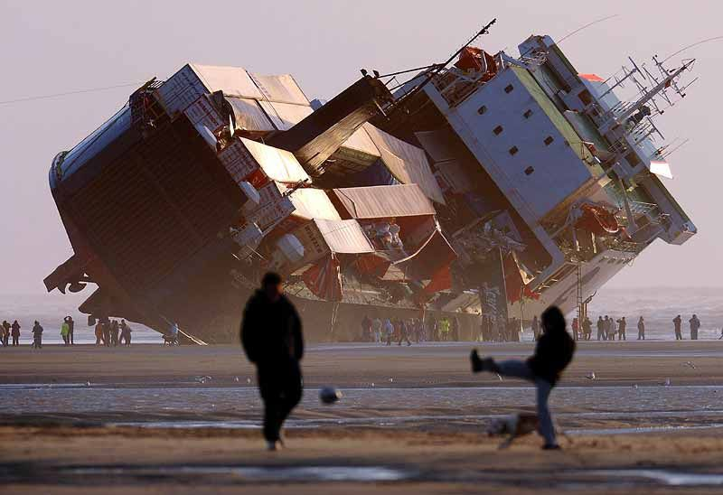 Shipping vessel with containers, grounded &inoperable.