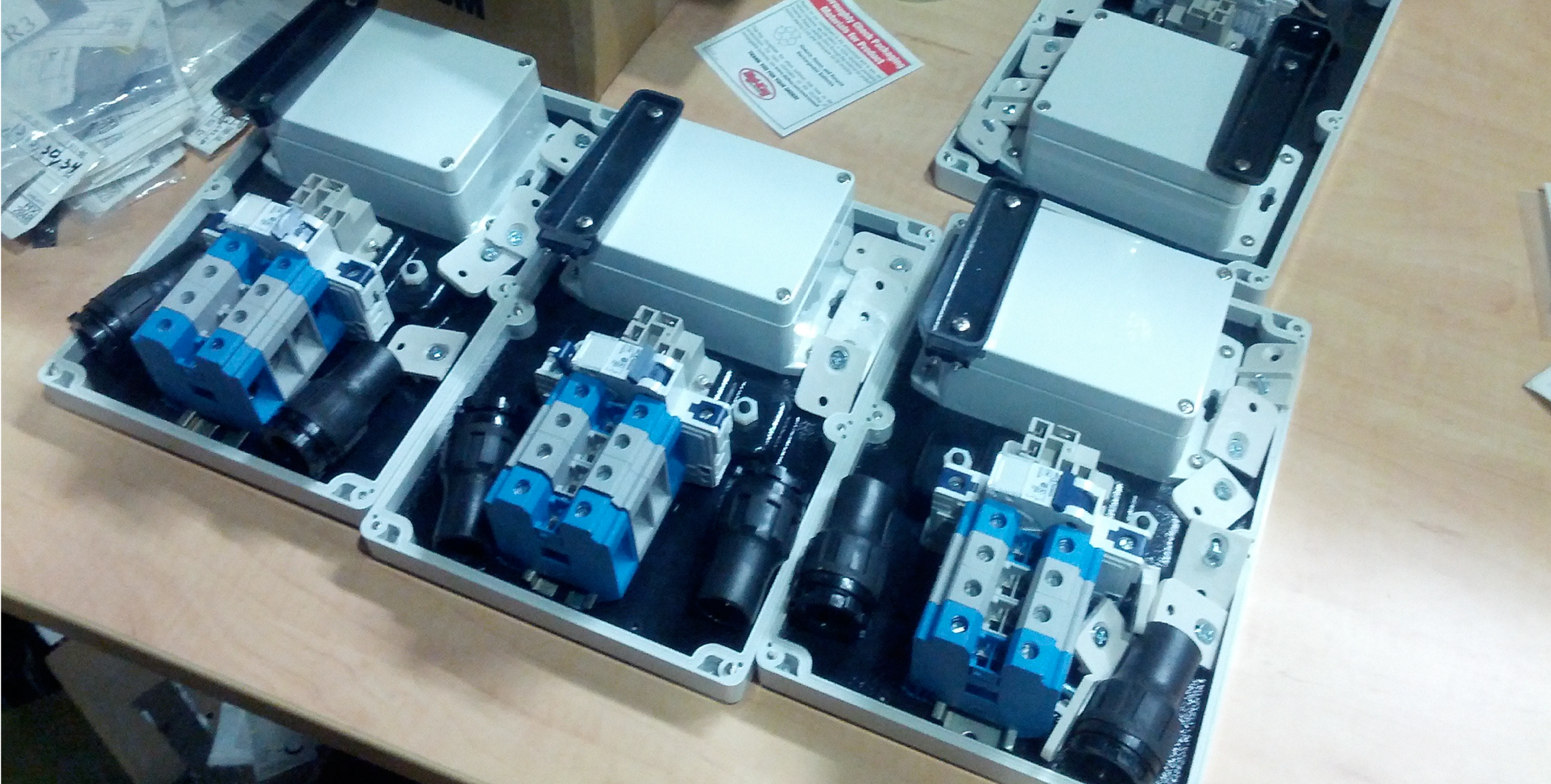 Partially assembled meters before shipping to pilot deployment.