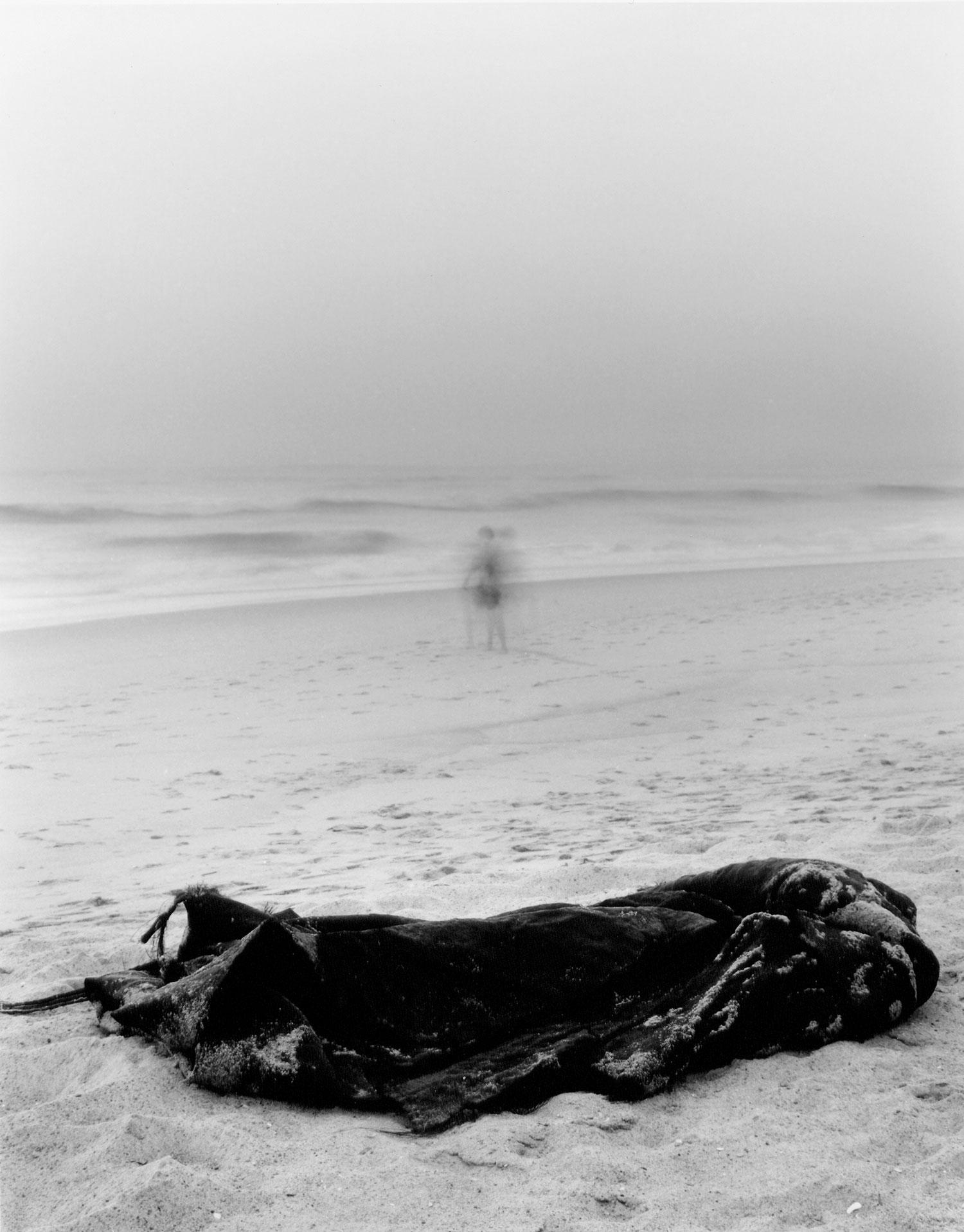 Passing (man on the beach)