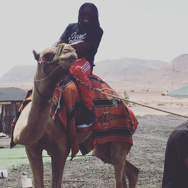 U heard of Neil Armstrong? Well this is Tony Tillman, the first man from the hood to ever ride a real camel in Israel in a real desert near the real Jericho Valley wearing Jordan retros! @israelcollective #BlackHistory #JordanXXXIII