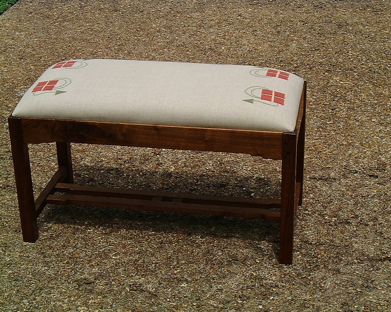 The Checkerberry here again on this Arts & Crafts piano bench is terra cotta and loden on natural linen