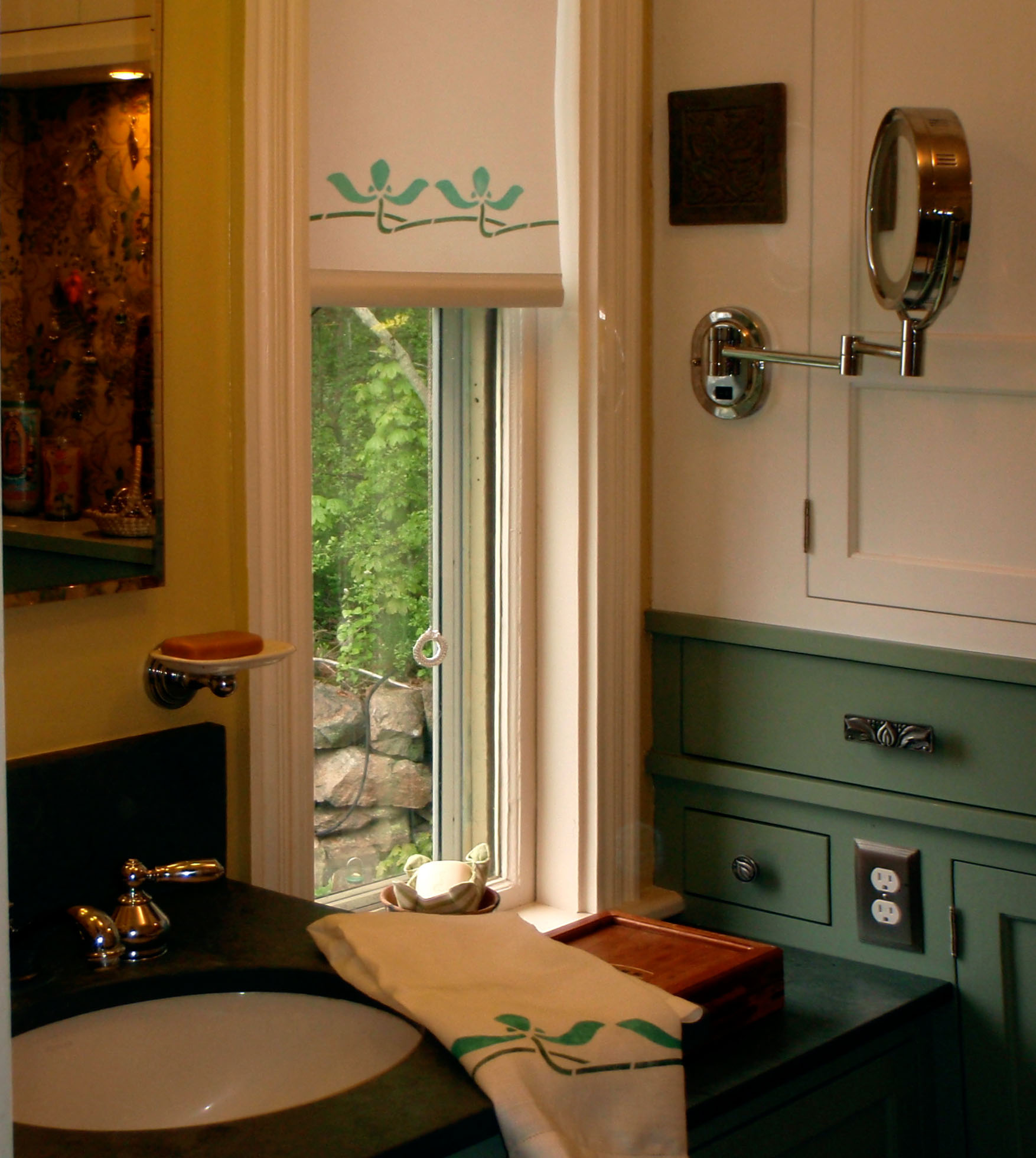 A stenciled shade with coordinated guest towels.