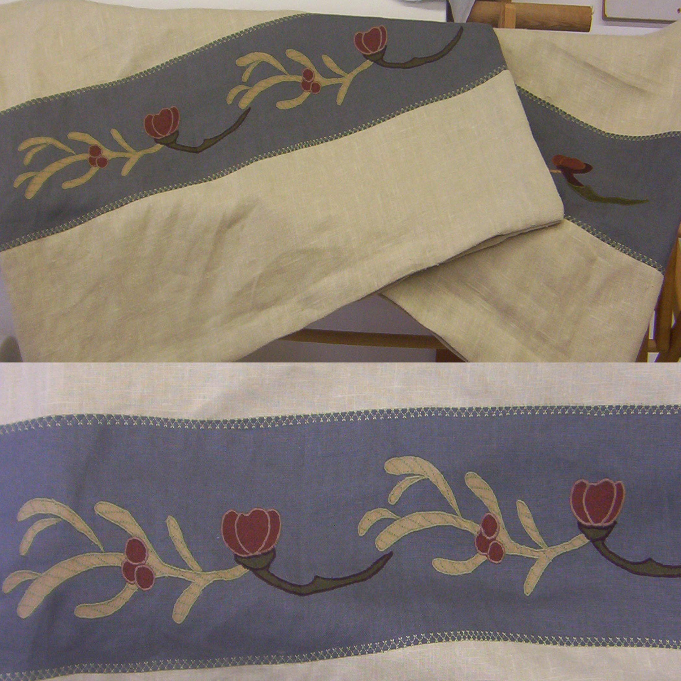 A custom applique border meant to coordinate with a Voysey wallpaper. This is a rather dense applique with triple top stitching in the leaves and we've thought too expensive to include in our stock designs!