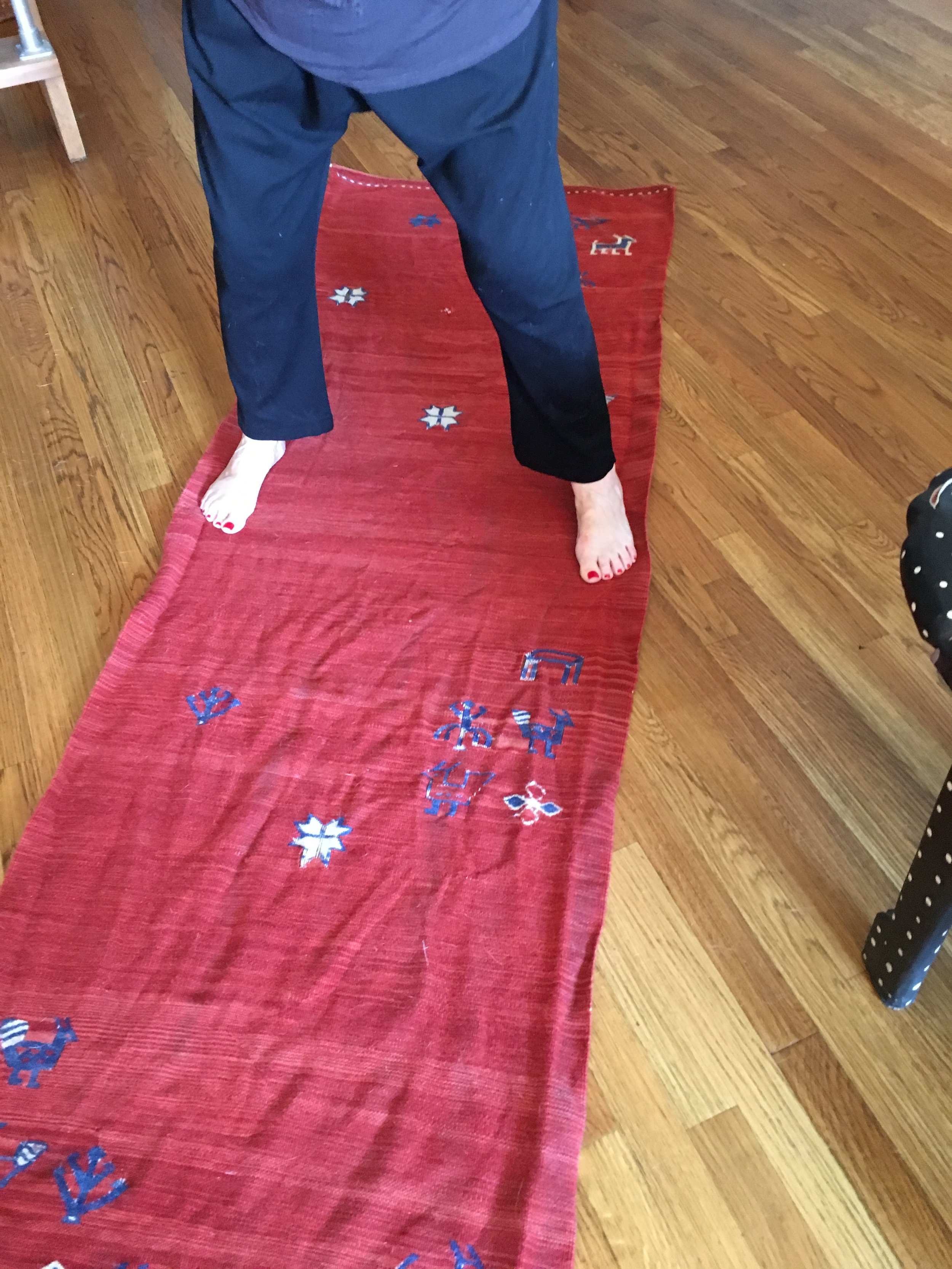 Block the rug. Having a friend help you pull on each end is helpful. Walk on it in bare feet and stretch.