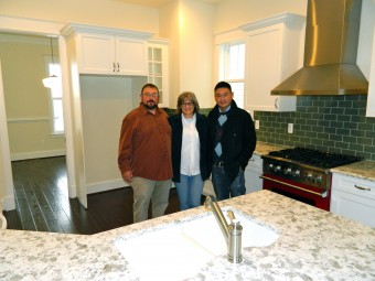 Marsha, with Parkwood superintendent Sam and her broker, Karl, in her beautiful new kitchen just before moving in.